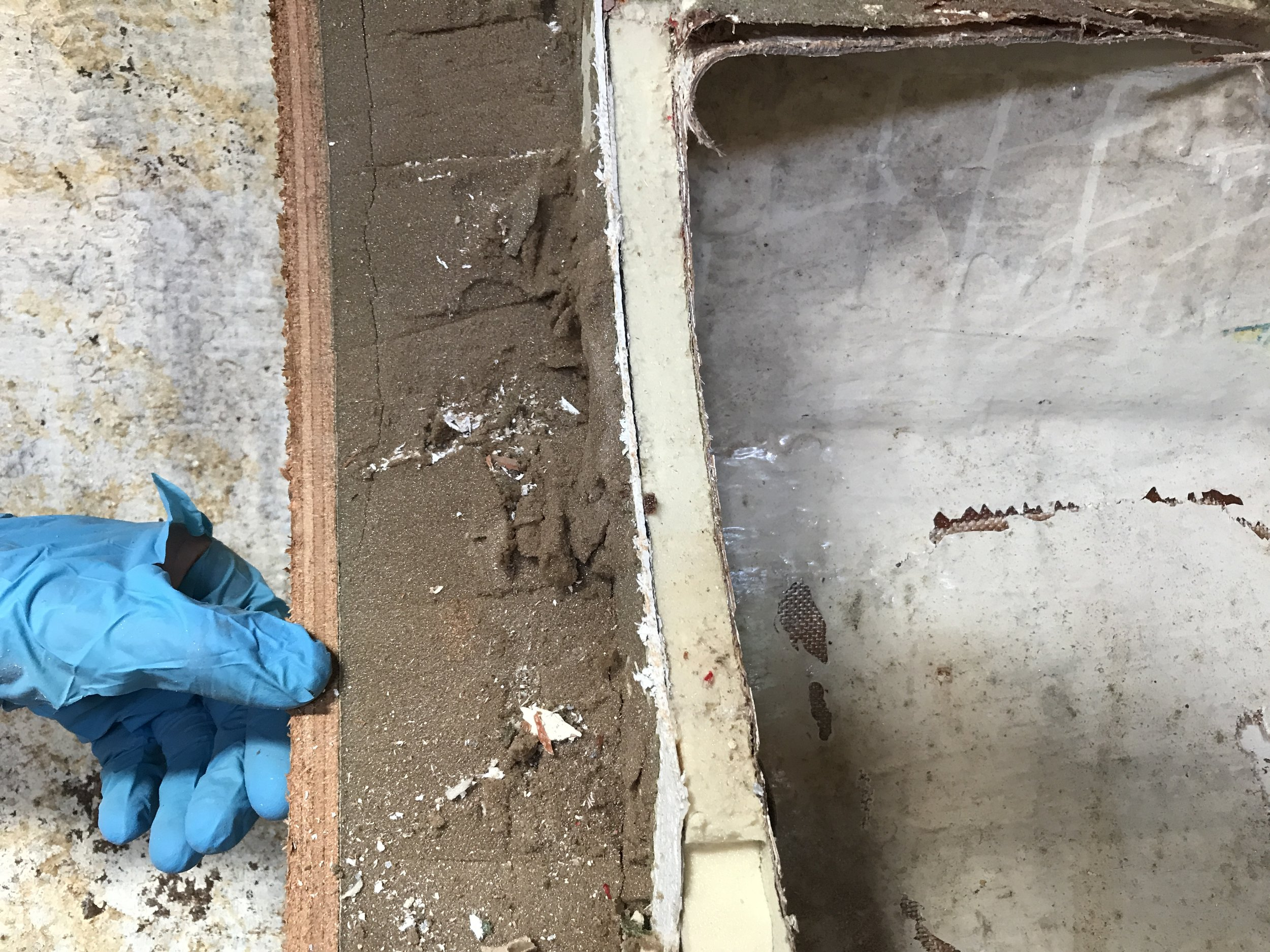 Old foam insulation (that sandy, dirty looking stuff) on the left.