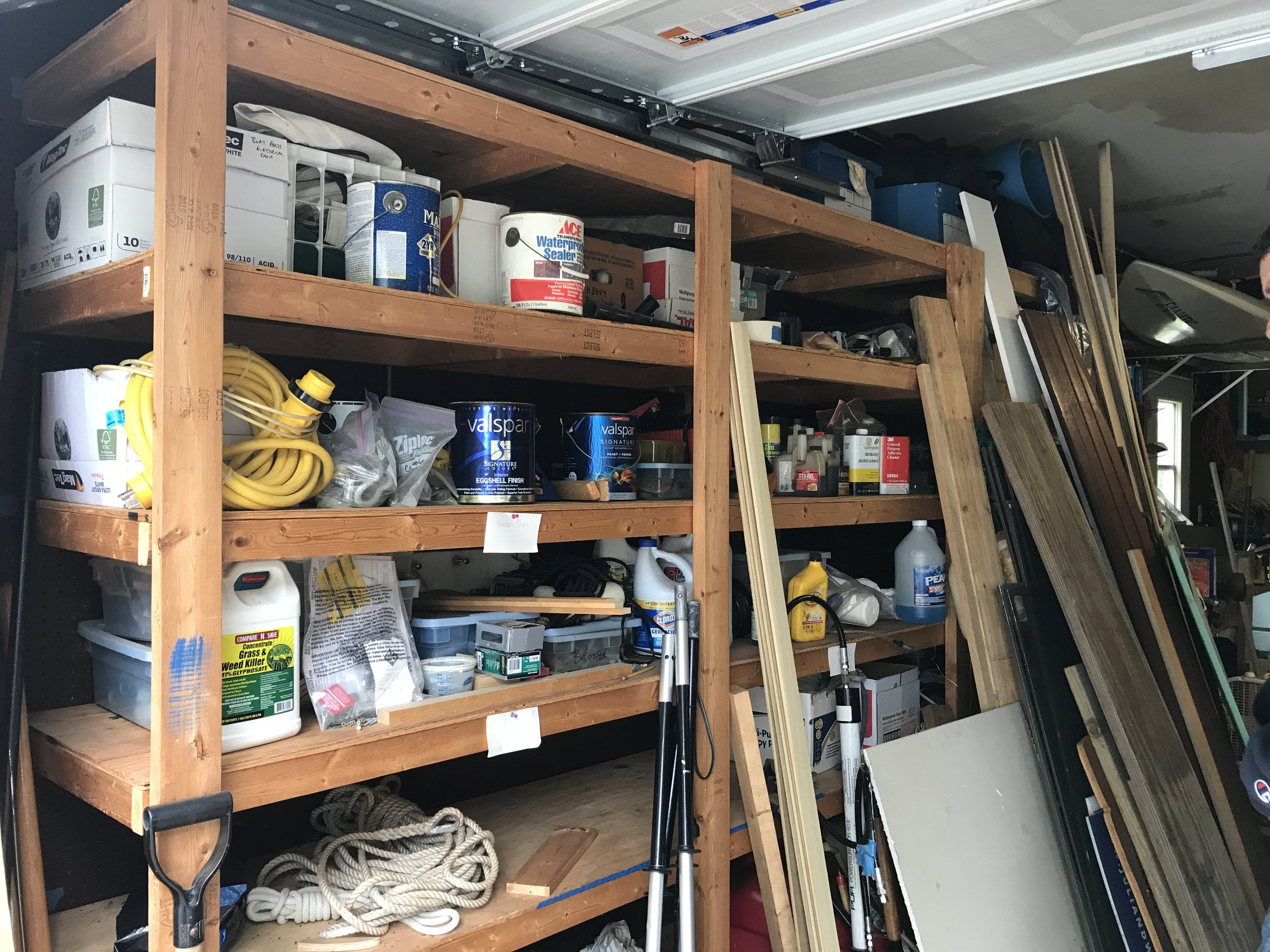 One shelf unit, AFTER a round of organizing.