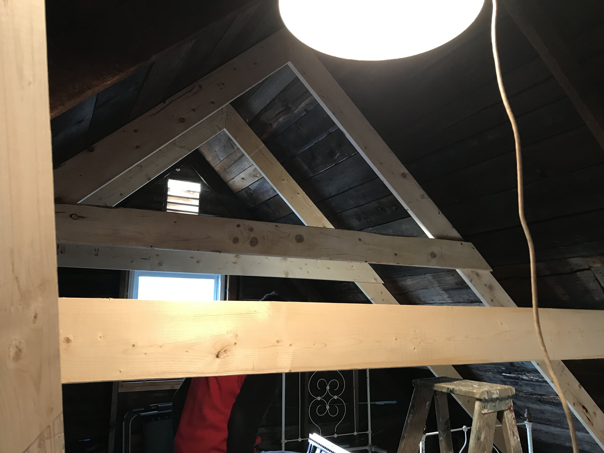 New rafters, shoring up the old ones, before adding new ones in between.