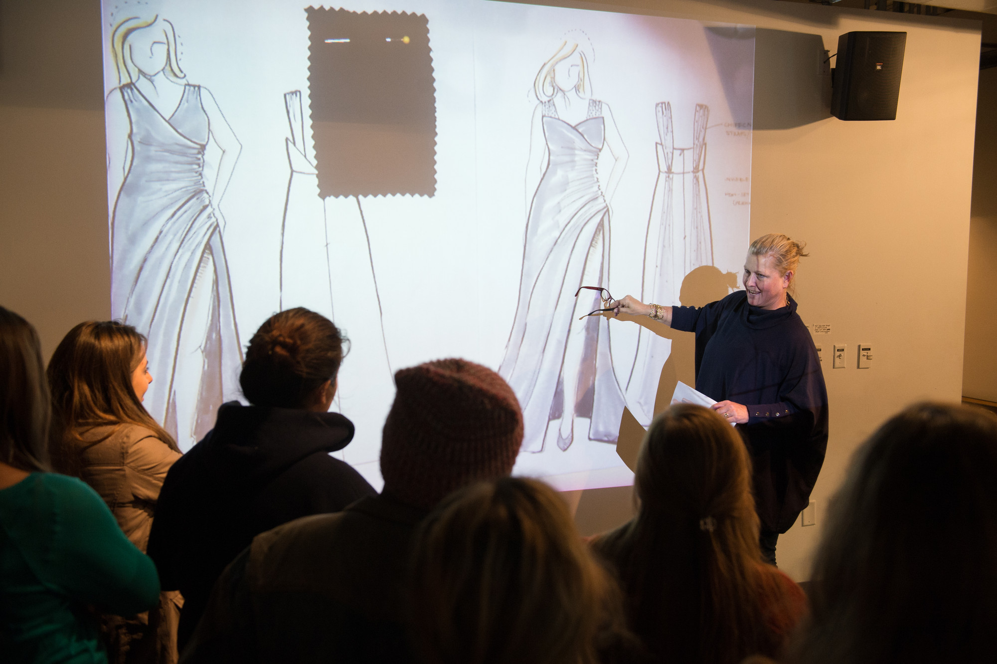 Supermodel Emme speaking with Syracuse University students at a Fashion without Limits clothing line sketch unveiling.