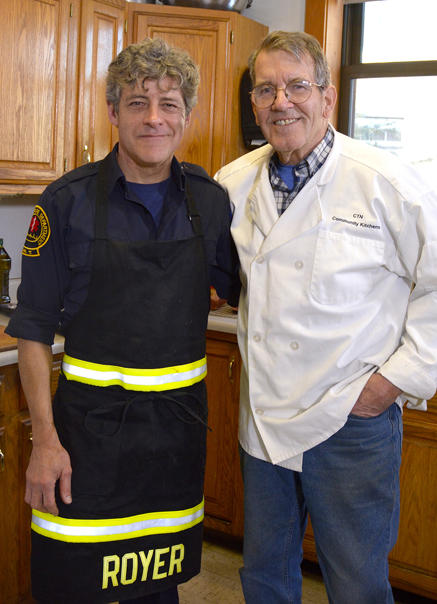 Host of Community Kitchens Roger Berle with Guest, Portland Firefighter Paul Royer  Photo by Lesley MacVane