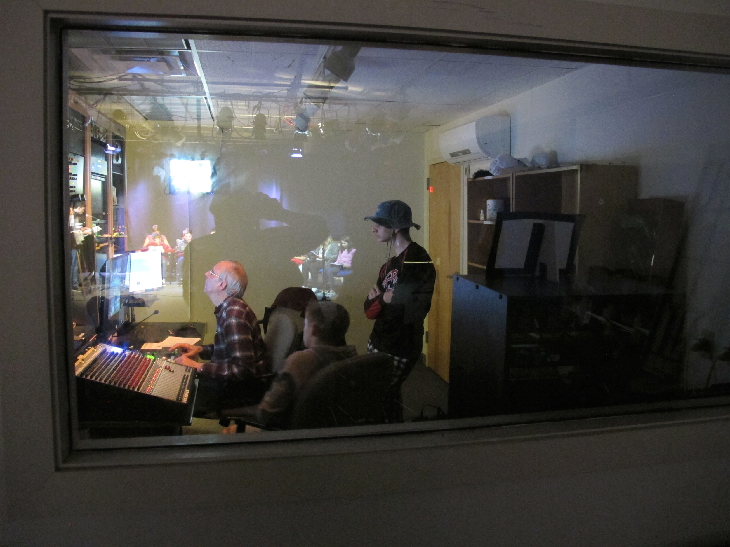 Scarborough middle school students watch Brian working the camera switcher in our control room