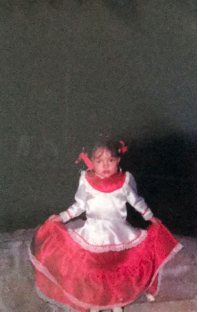 [Me, 4-5 years old, wearing a traditional outfit of tierra caliente hand-made by my aunt]