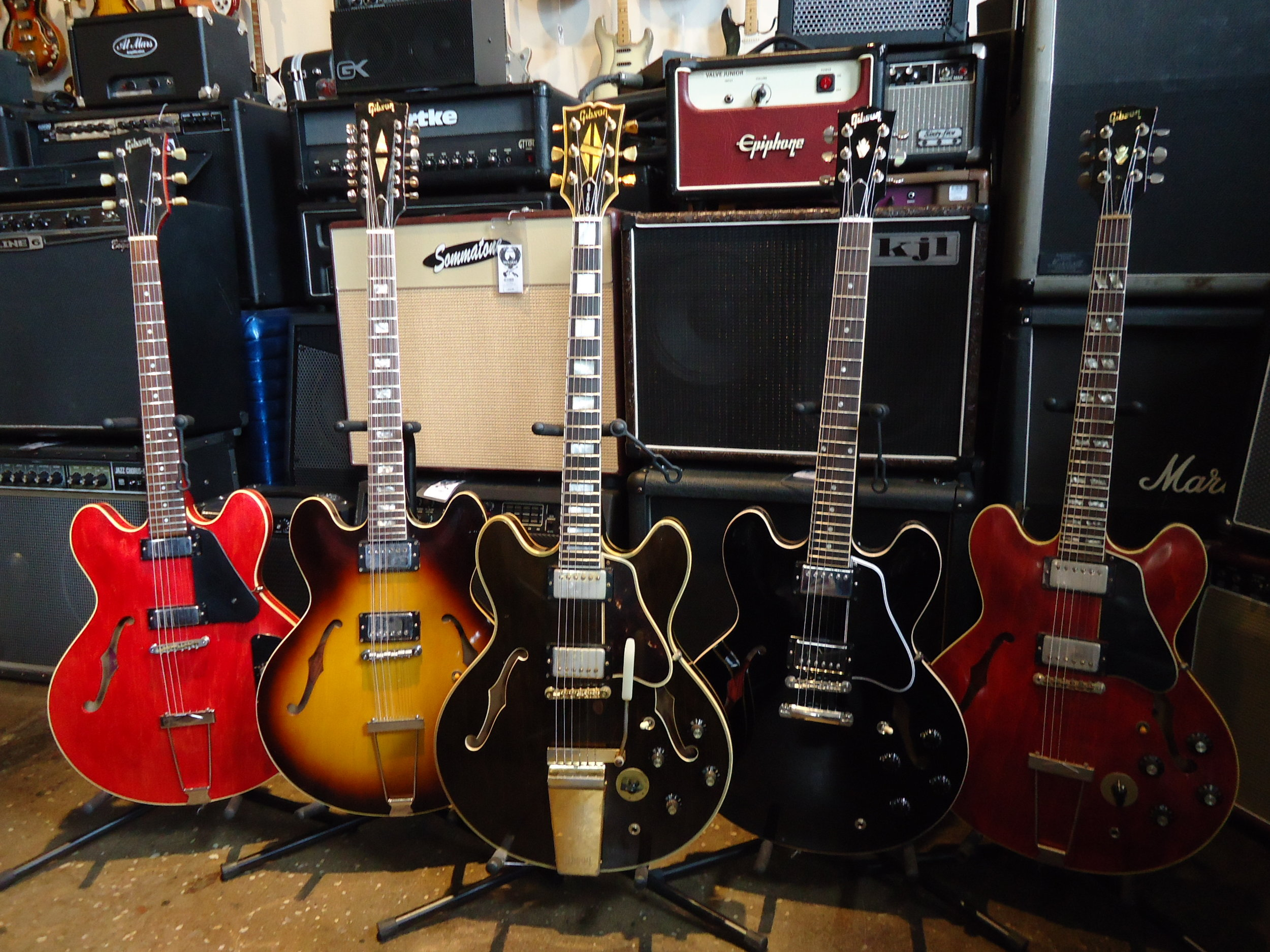 A family of Gibson ES guitars""