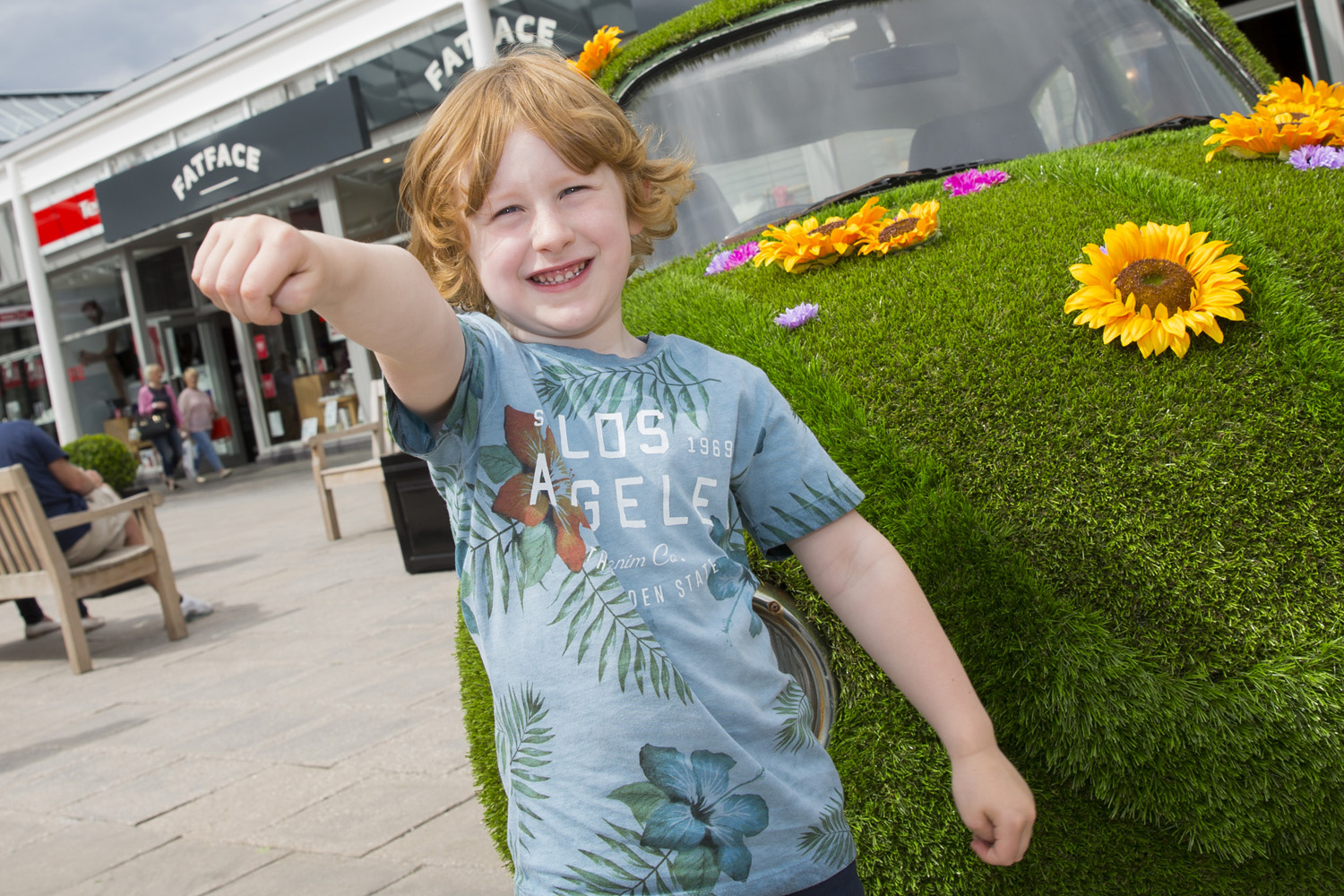 McArthurGlen Designer Outlet Bridgend launches Festival of Summer - local boy with Topiary Bug.JPG