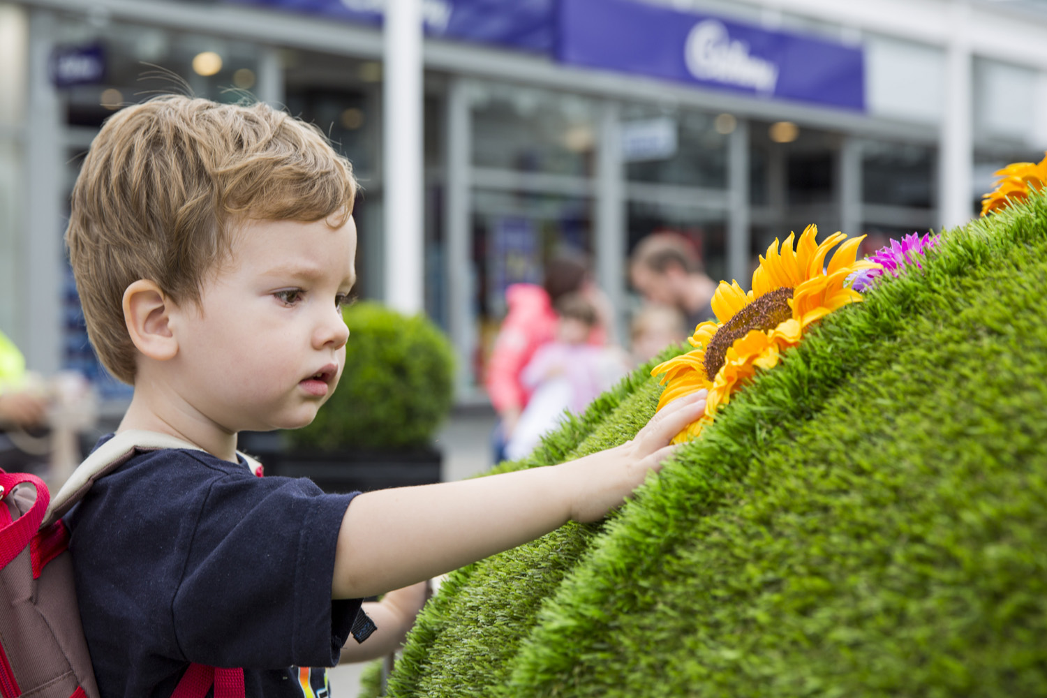 McArthurGlen Designer Outlet Bridgend launches Festival of Summer - young boy with Topiary Bug.JPG