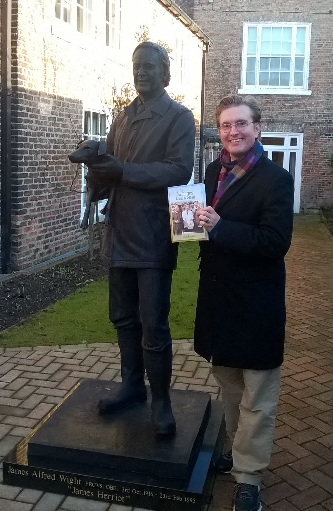 Author of All Memories Great and Small Oliver Crocker, pictured with the statue of Alf Wight (James Herriot) at The World of James Herriot Museum in Thirsk, North Yorkshire