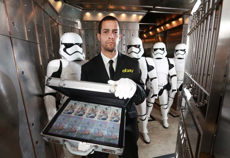 Jon Alagoa ( eBay security guard) and Stormtroopers stand guard as eBay and De La Rue launch an official commemorative note for charity on December 7th, to mark the upcoming film release of Star Wars: The Last Jedi as part of the GREAT Britain campaign, Photo credit:Matt Alexander/PA Wire