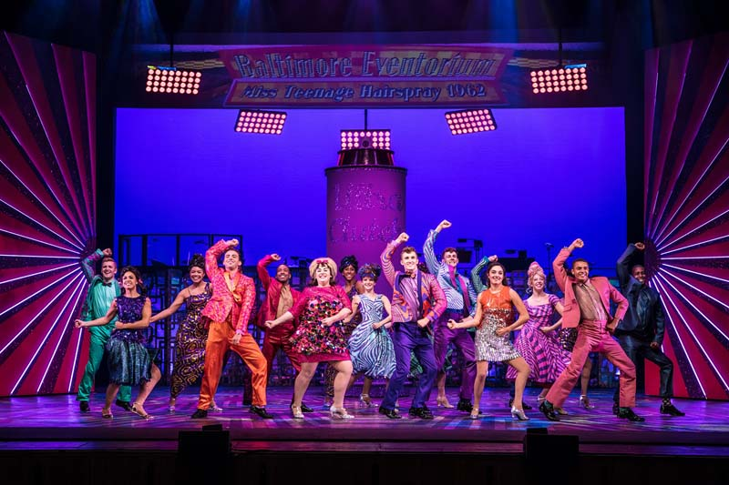 An ensemble scene from Hairspray, playing Bristol Hippodrome from March 5-10