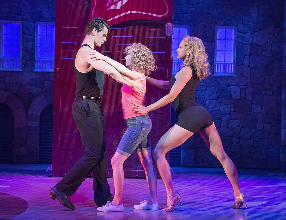 Michael O'Reilly (Johnny) Kira Malou (Baby) Simone Covele (Penny) in Dirty Dancing - The Classic Story on Stage; Photo credit Alastair Muir