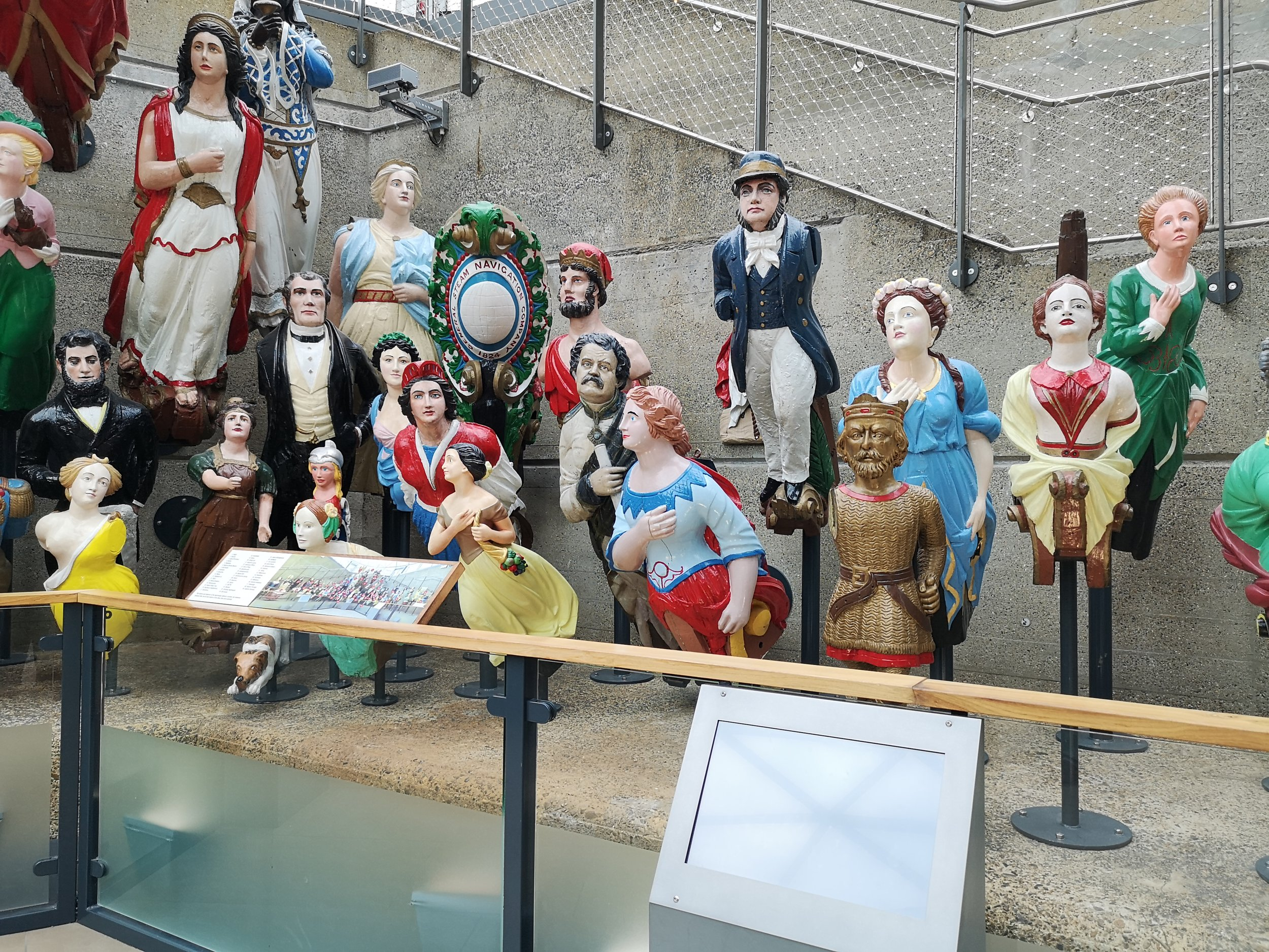 A display of figureheads at the Cutty Sark museum, Greenwich.