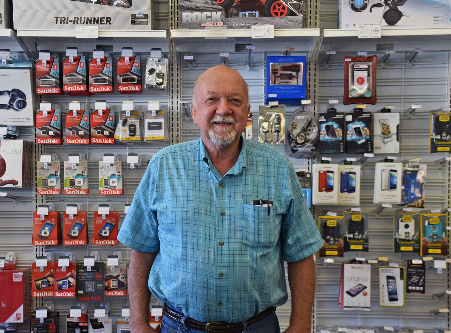 Ernie Branscomb, pictured in his Garberville store, remembers when the rodeo was the biggest event in town. (Sandy Feretto)
