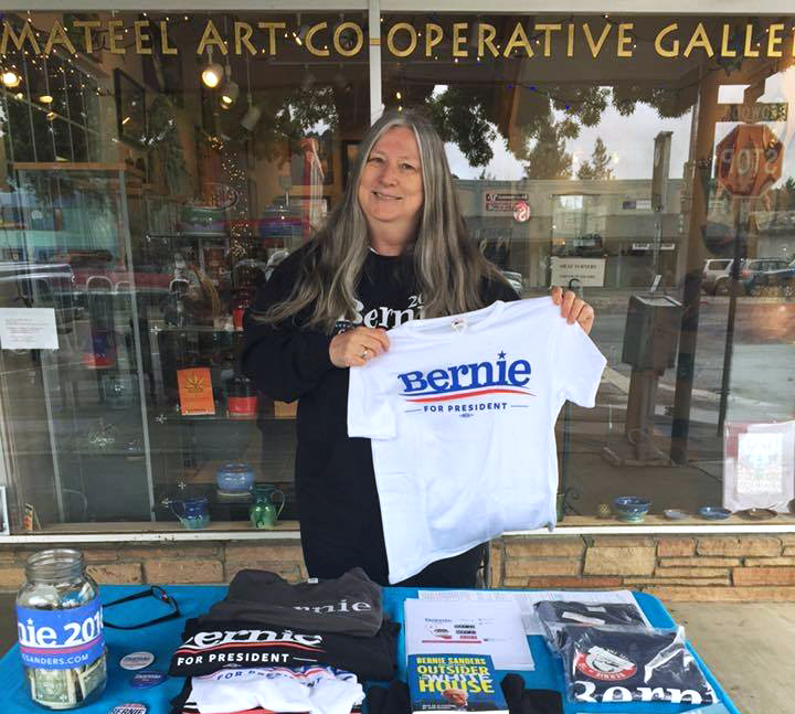 "Redway resident Gillian Brown, shown tabling for Bernie Sanders in April, said on Wednesday, ""Those of us who are his campaign people will keep on going."" (Photo courtesy of Gillian Brown)"