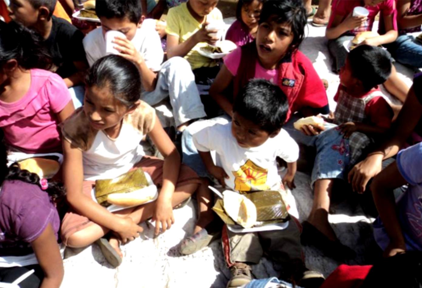 Providing a meal at a children's program — Guatemala