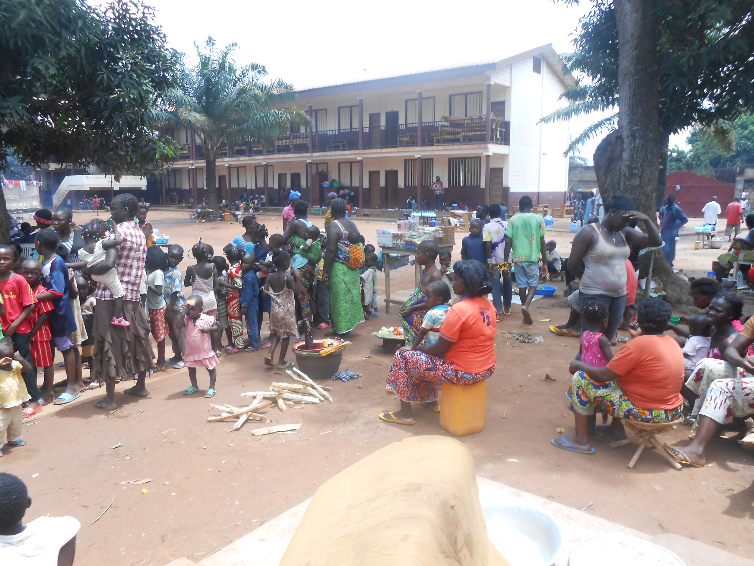 Feeding at IDP camp at School.JPG