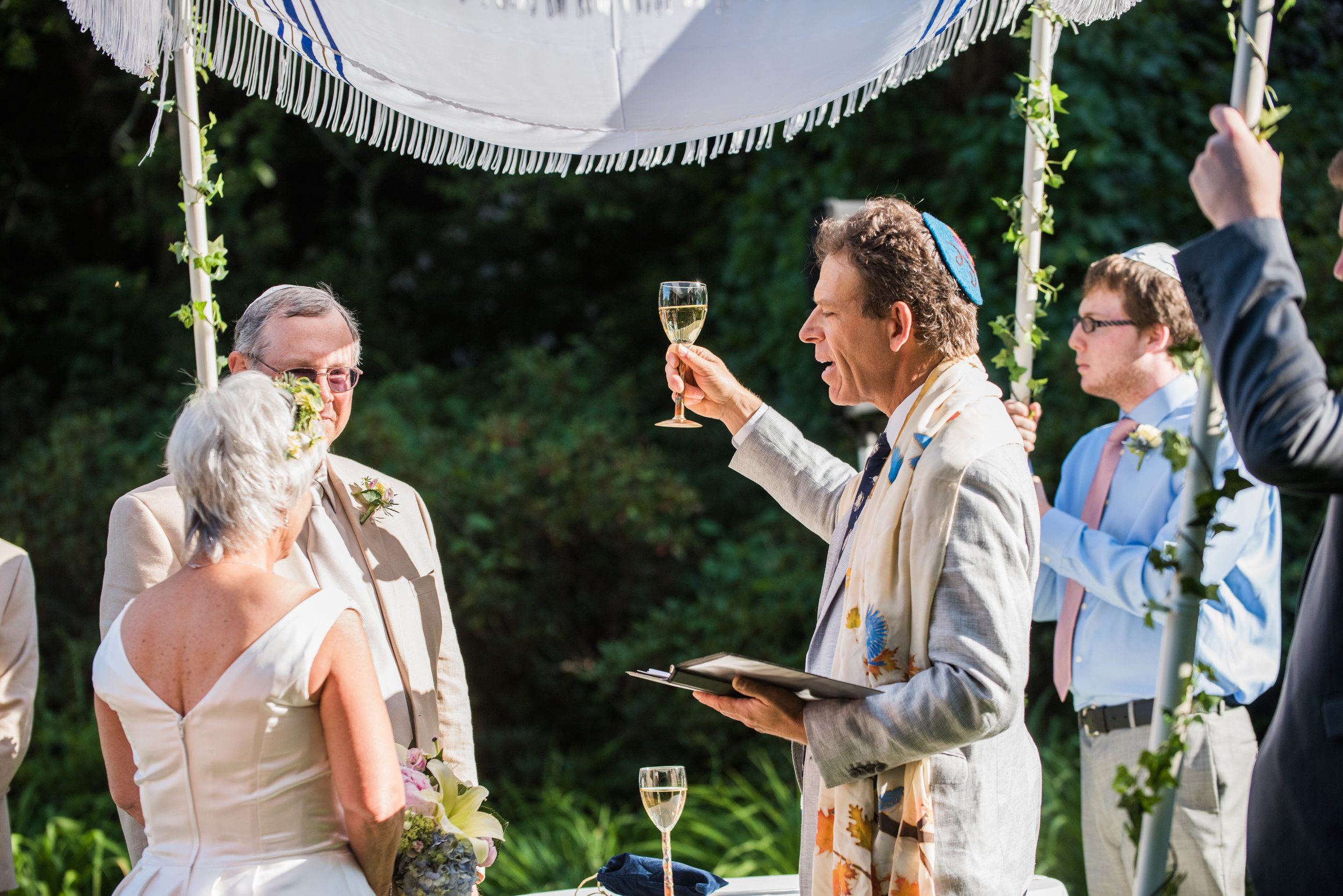 Sherri Wedding Under the Chuppah with Wine Glass.jpg