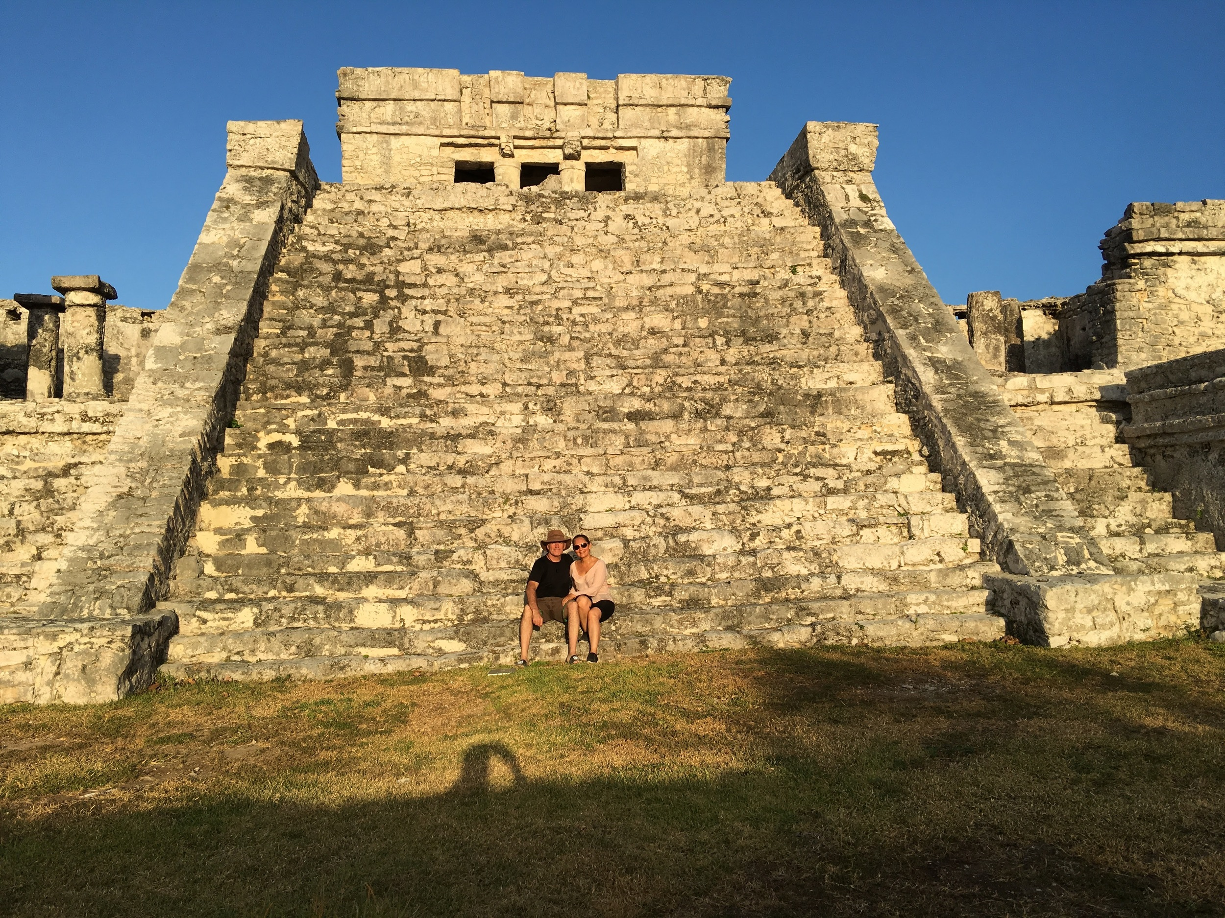 A security guard let us jump the rope and sit on the main pyramid for this photo.
