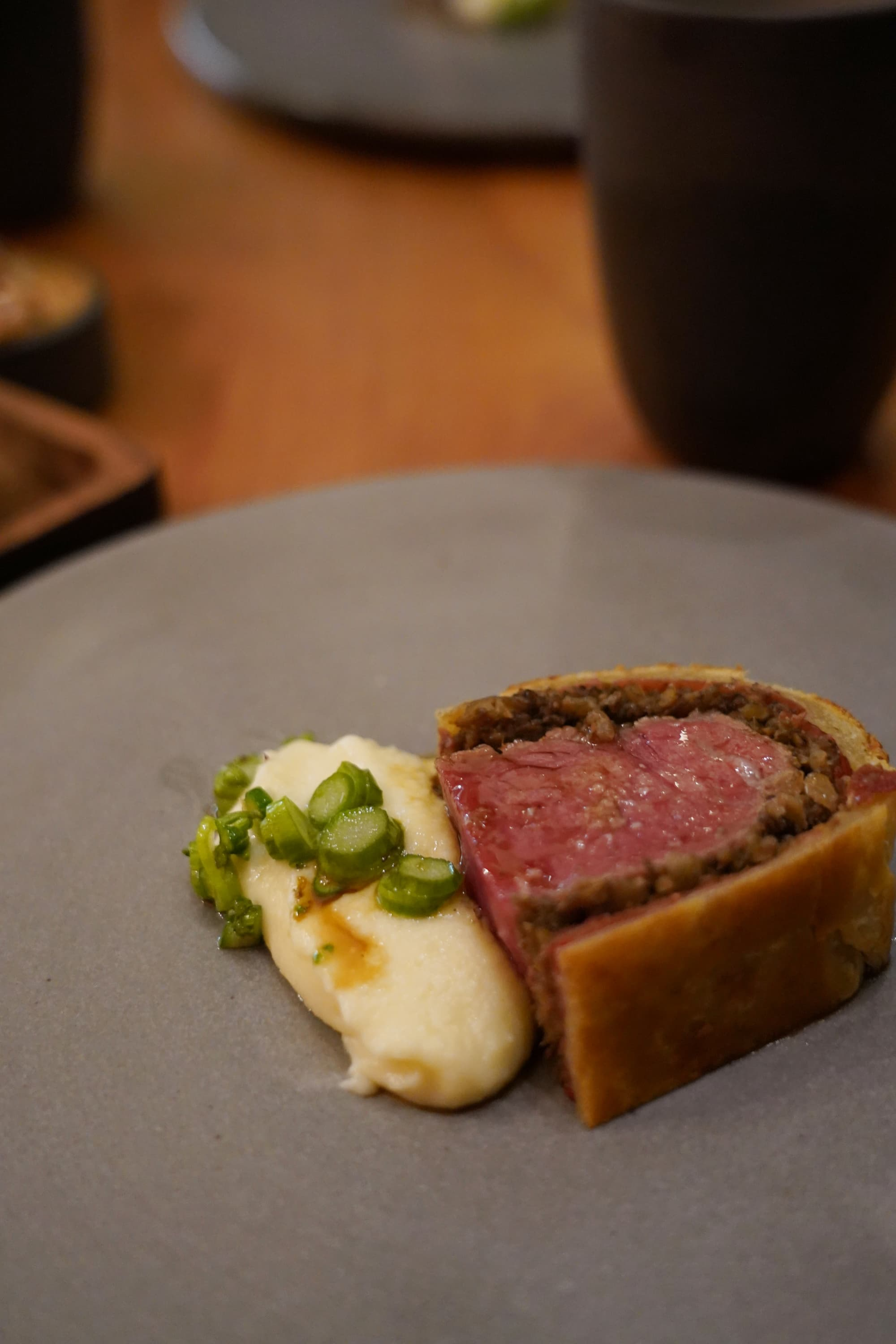 Beef Wellington and potato puree with asparagus.