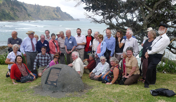 Photo Rodney Times: Ground-breaking research on the Greenwood's former Pakiri cliff farm, in the background, brought the family into contact with radio astronomers at the plaque unveiling at the Leigh Marine Reserve.