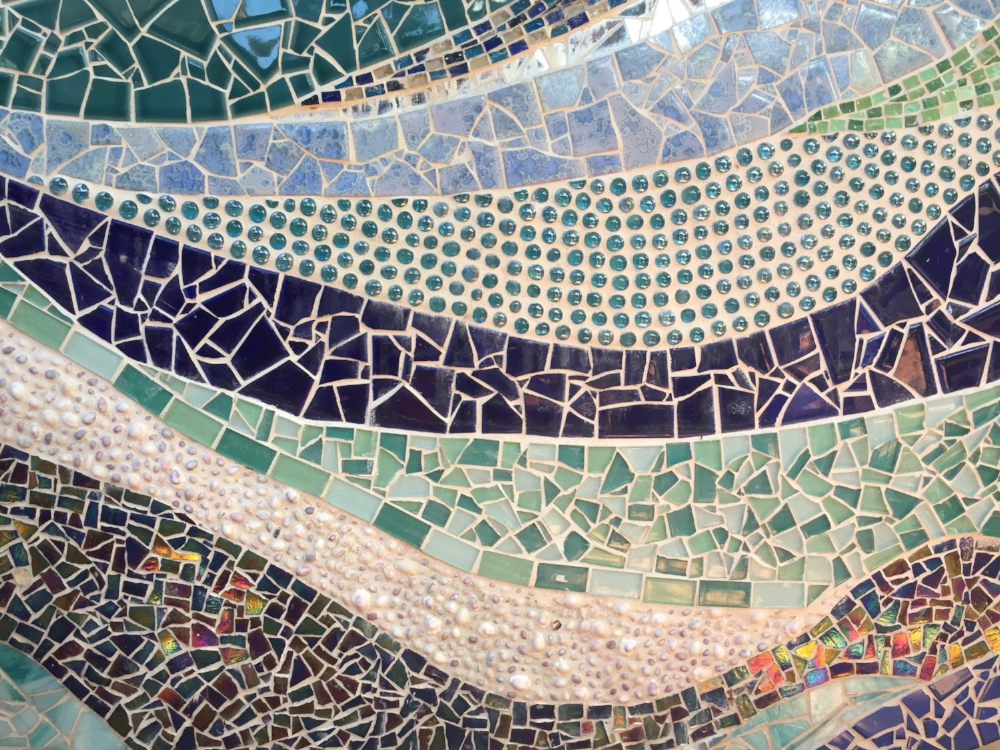 Detail of an abstract mosaic wall created by Donna Nabavi.