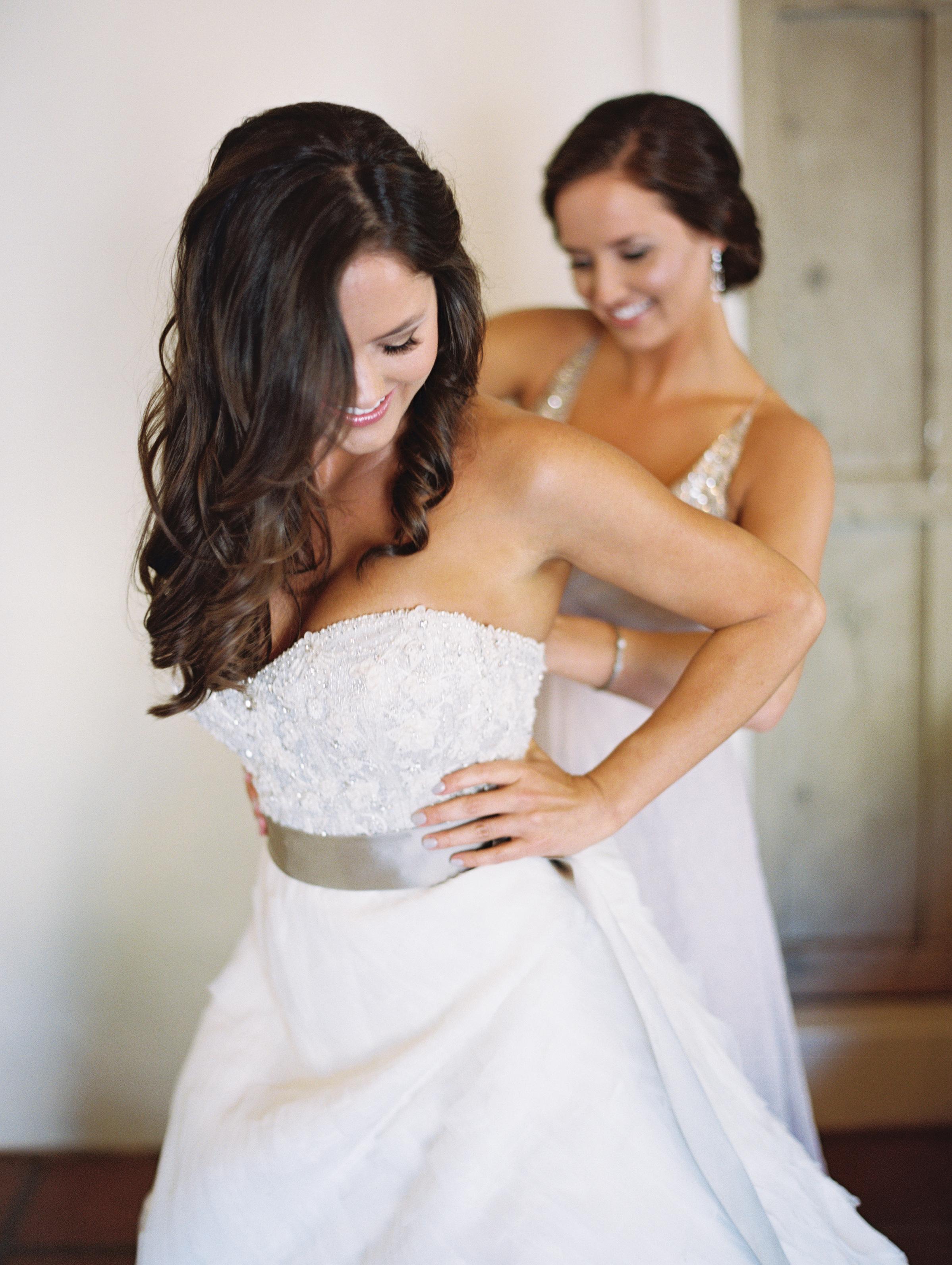 getting_ready_putting_on_wedding_Dress.jpg