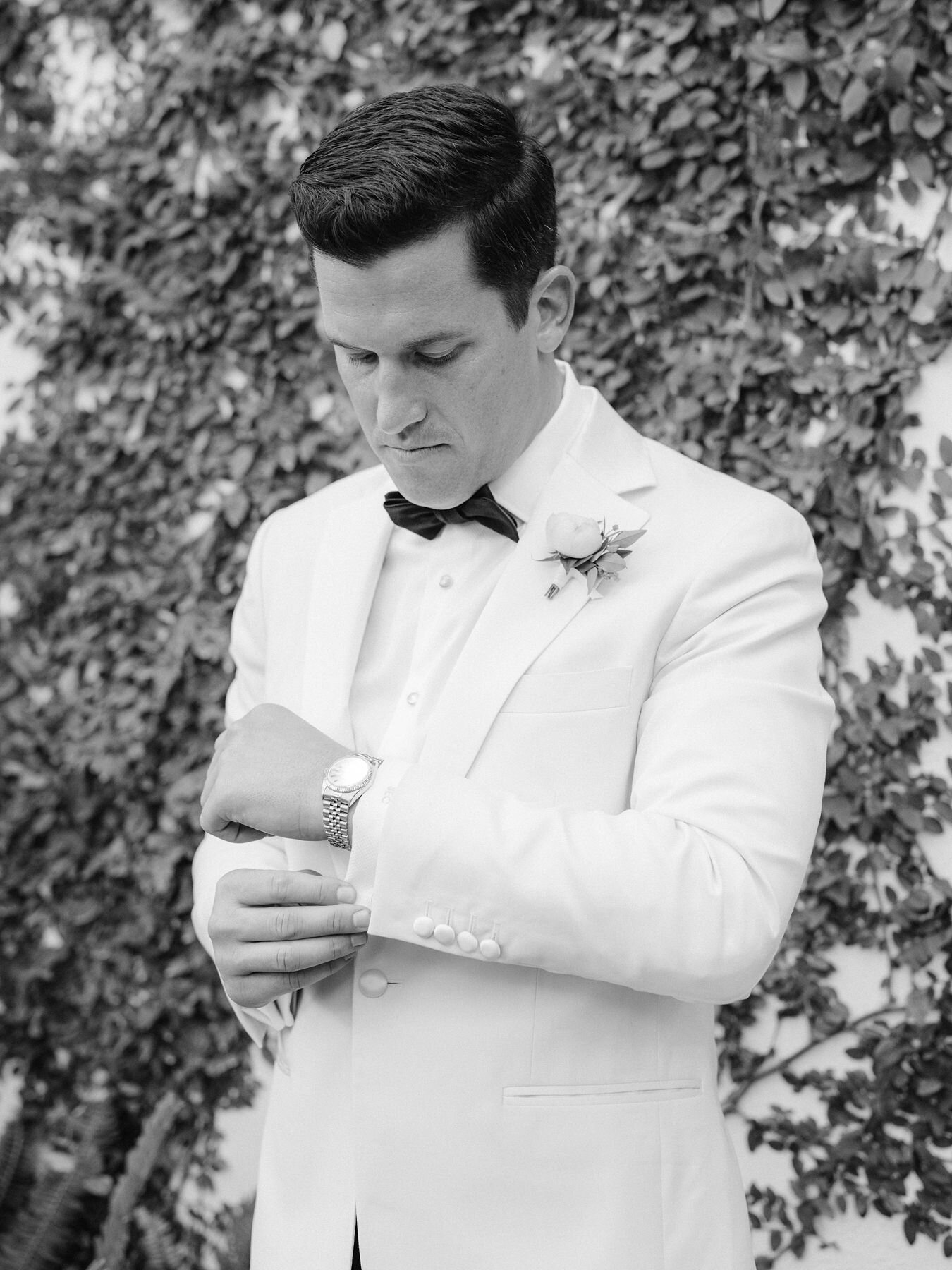 Our groom putting the finishes touches on before the first look
