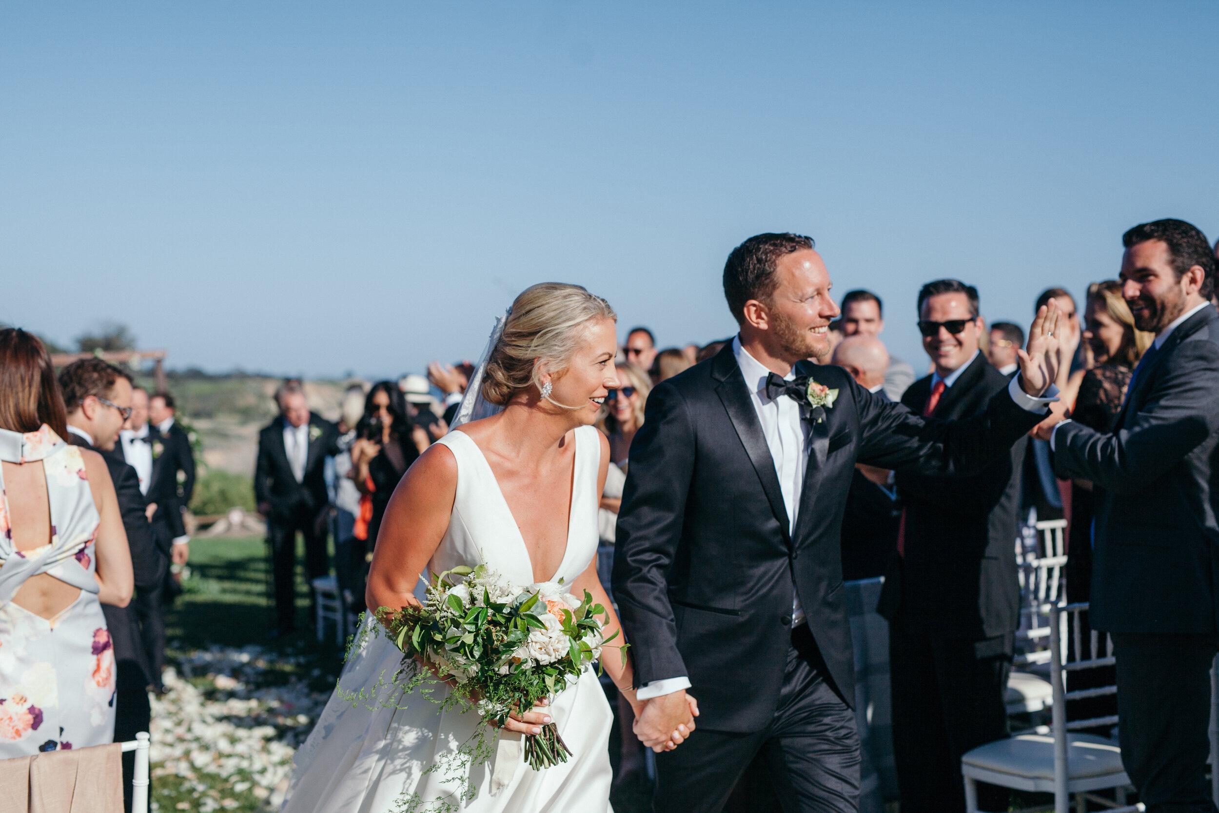 Bacara_bluff_ceremony_recessinal_just_married_KRP-KA-Wedding-Day-0545.jpg