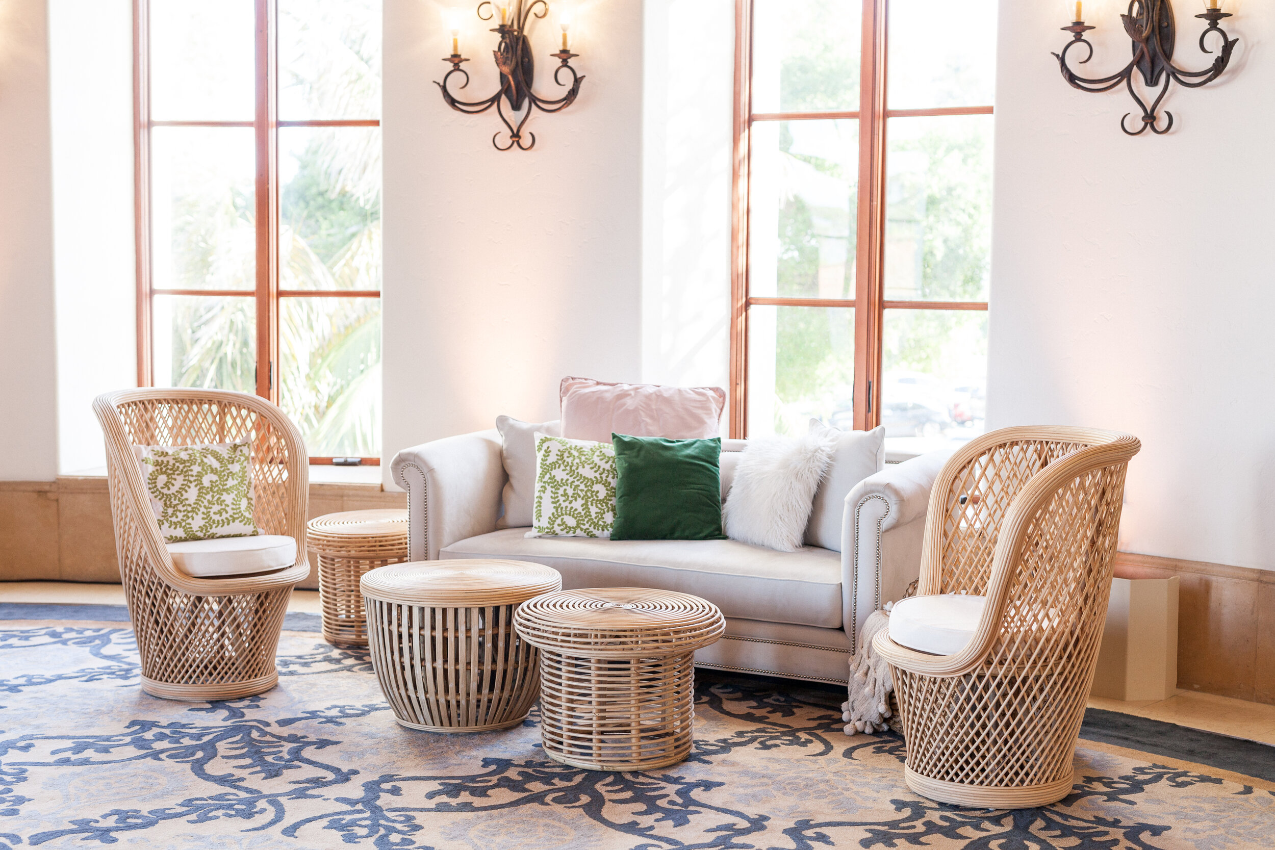 Kate and Alex opted for lounges around the dance floor in a natural tone to match their invitation suite and we popped the lounges with colorful pillows in green and blush