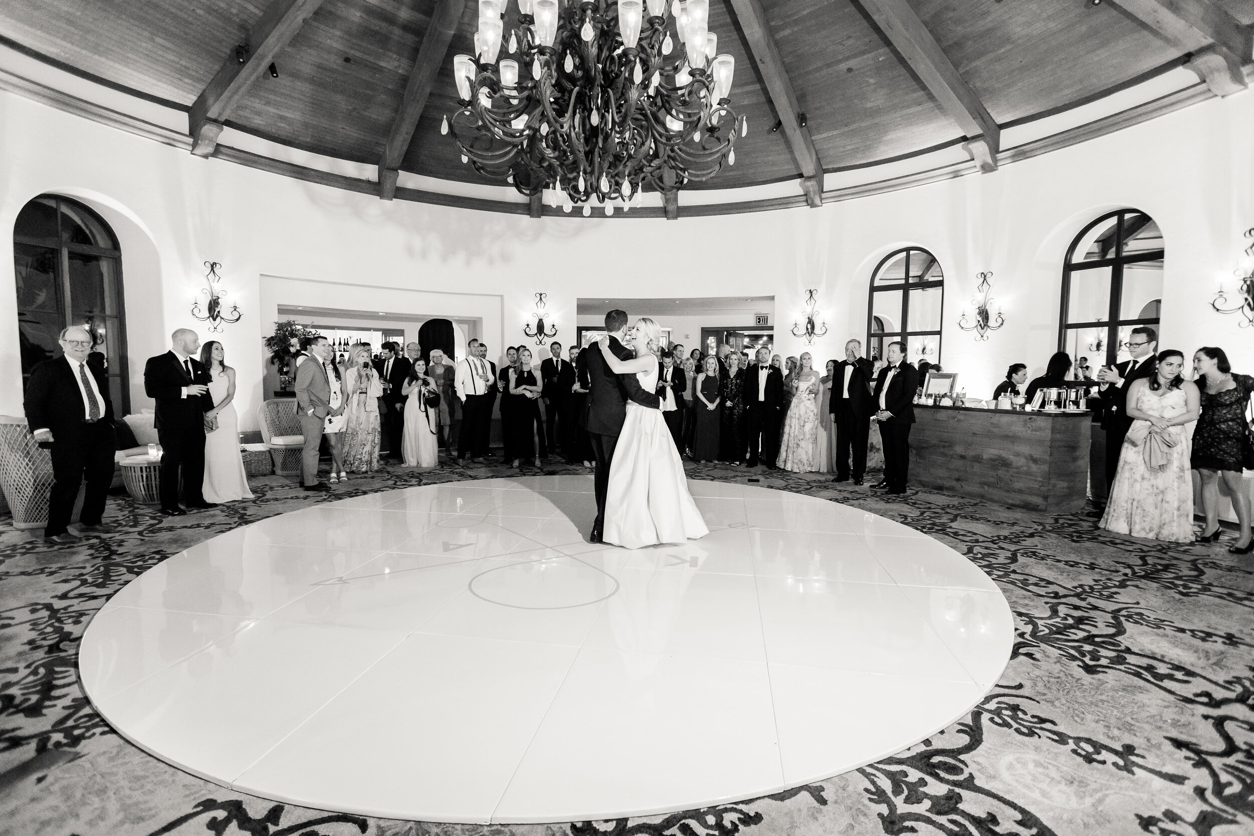 First dance as husband and wife on a custom seamless round dance floor with their logo in blush pink