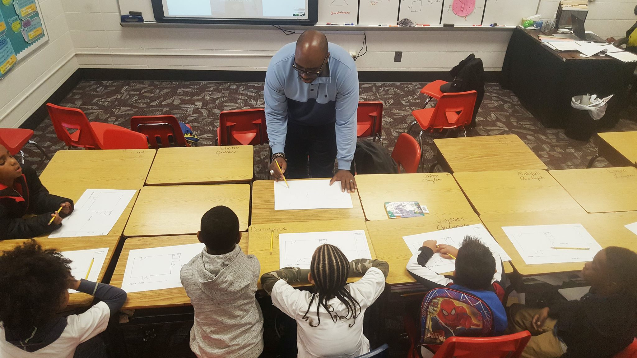 Tarchitects CEO Tariq Abdullah shows young Douglasville, GA students how they, too, can be an architect.