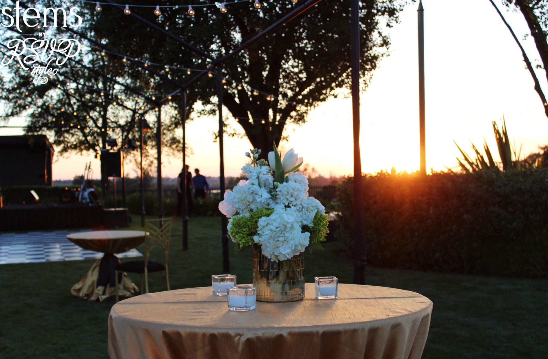 Cocktail table centerpieces at sunset