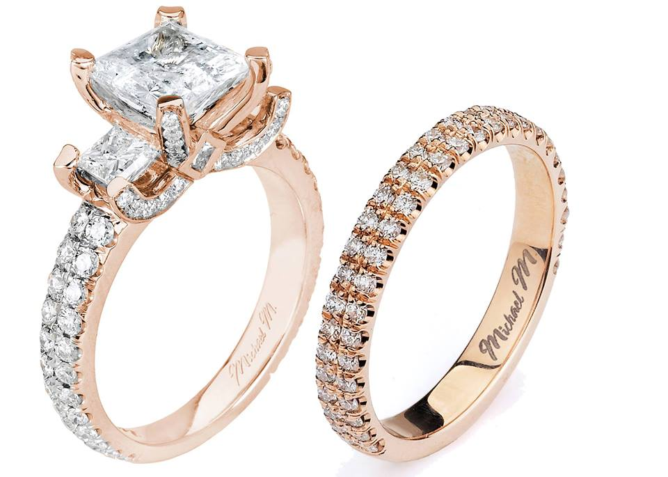 A unique Design of Diamonds fill and create eclectic shapes surrounding the center stone of this precious Rose Gold Setting!