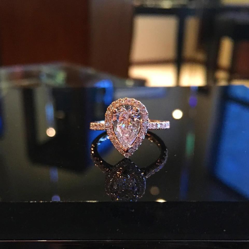 pear shape diamond engagement ring 18K rose gold with halo and infinity diamond band