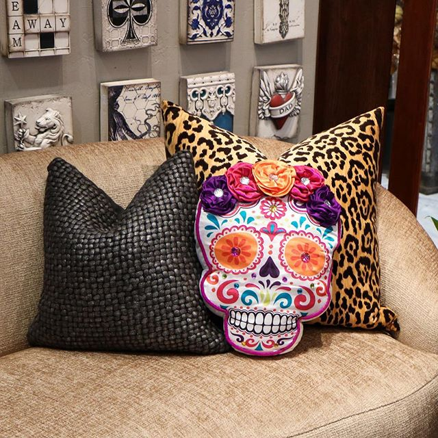 Do away with the spooky decor & bring in the beautiful #DiaDeLosMuertos colors & patterns! Doesn't this pillow make you think of @pixarcoco?!😍💀🎃 🎸 • available in-store #onlyATrsvp