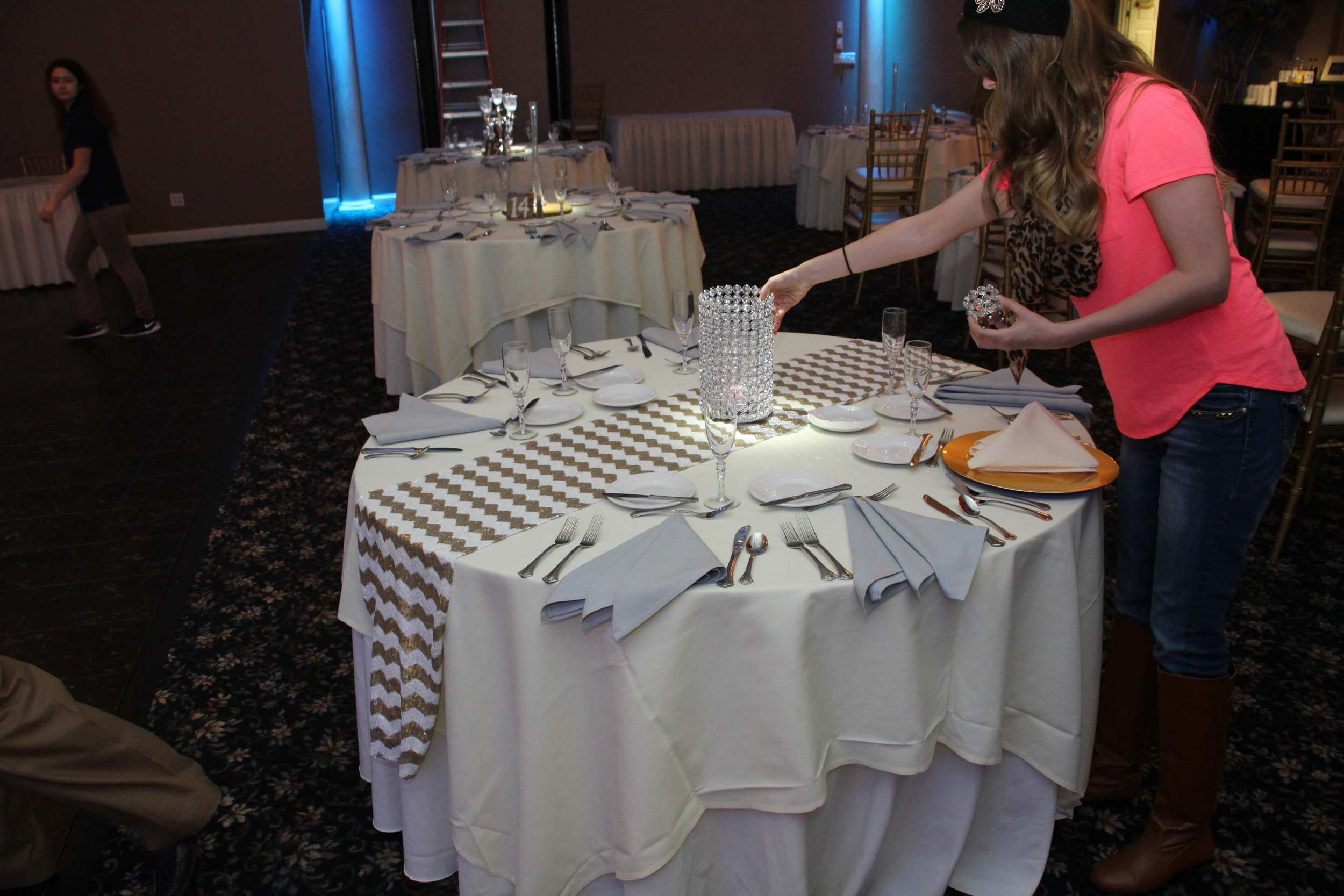 Getting the 'true feel' in the ballroom with table settings and pin spotting!
