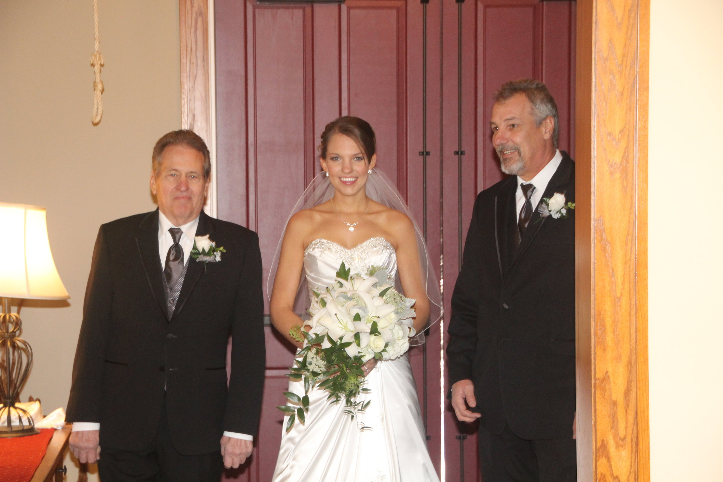 Brittany was escorted down the aisle by both her father and grandfather. I thought that was SO sweet!