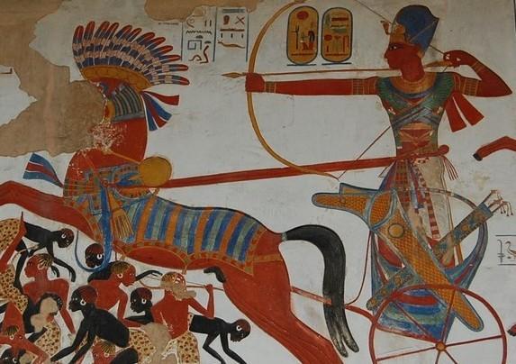 Queen Nefertiti wears a silk scarf under a headdress.