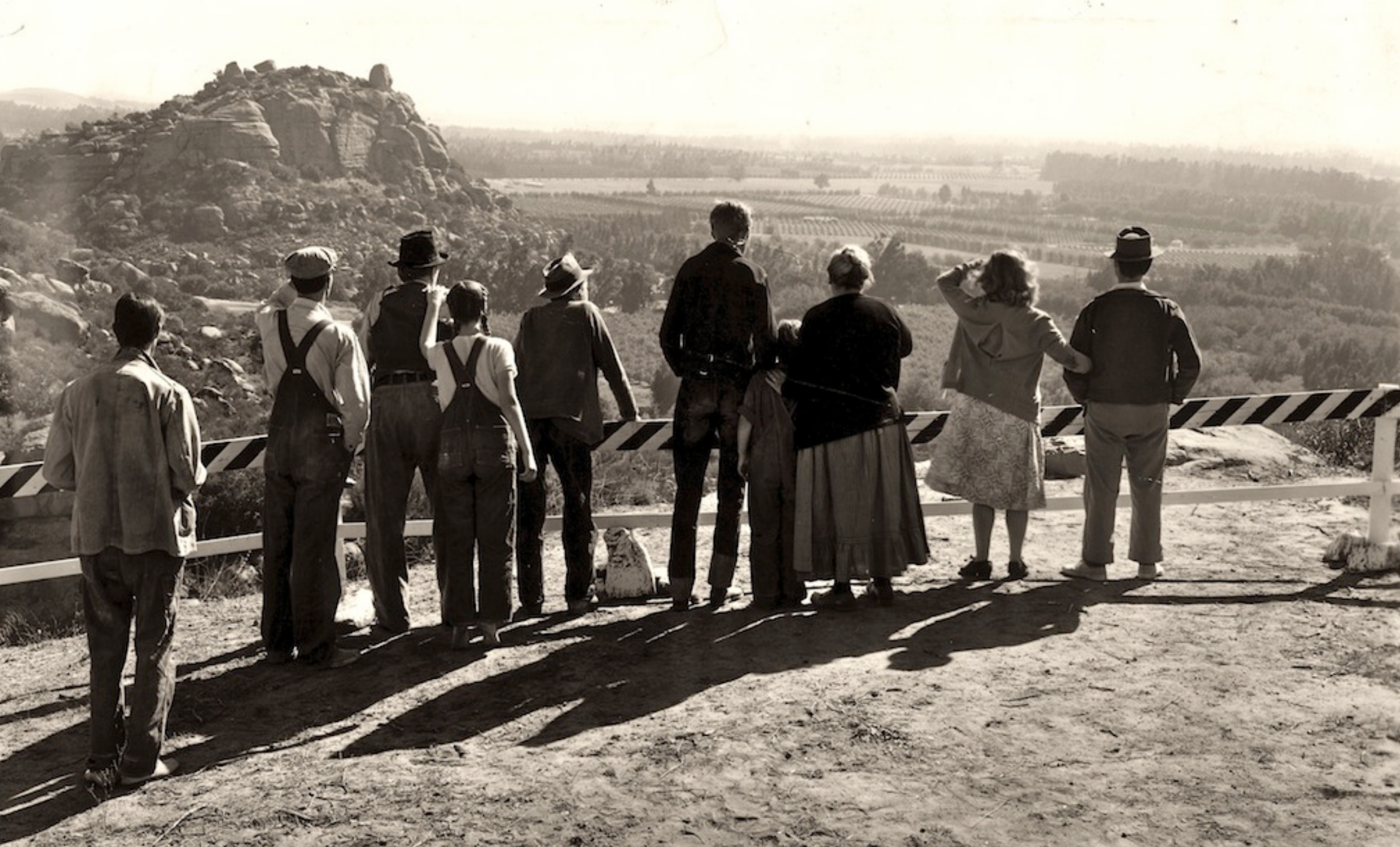 The 1940 film rendition of The Grapes of Wrath portrays the displaced Joad Family and their first glance at California.