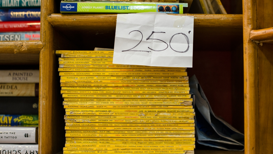 A stack of National Geographic magazines sit at Chan's store in Kenya. They cost 250 shillings.