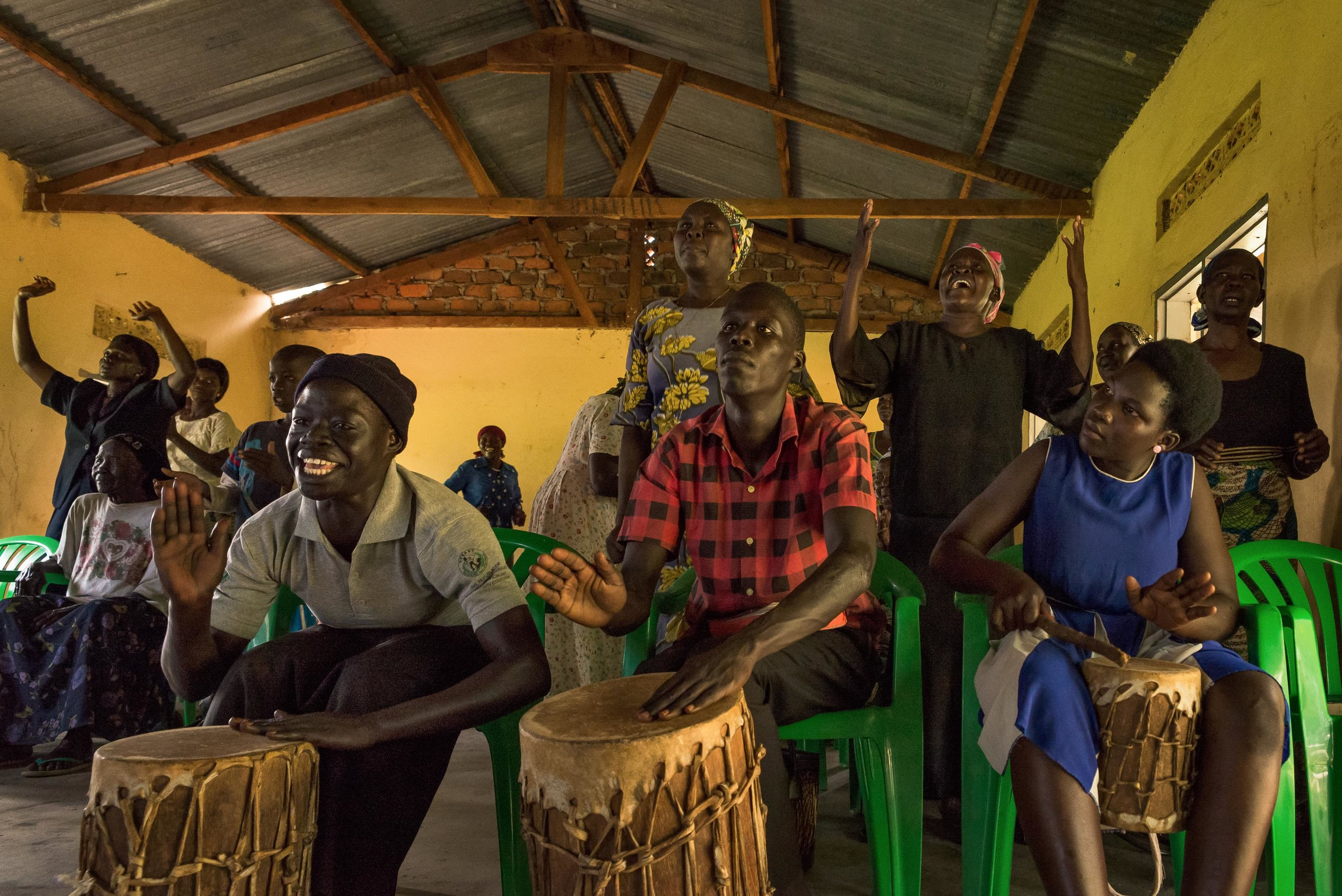 Refugees from Western Equatoria beat animal-skin drums during a PUSH service in northern Uganda.