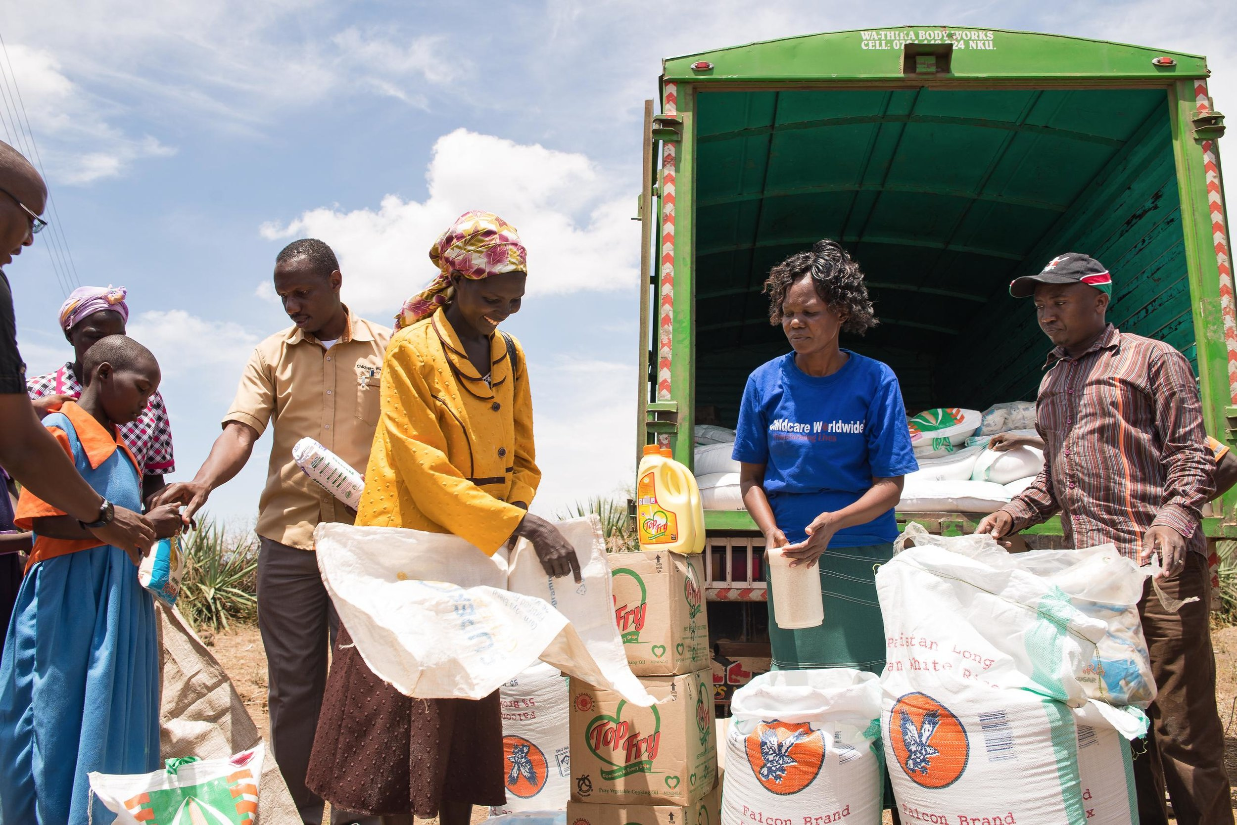 Families wait for emergency food relief at a distribution site in Baringo County, Kenya. Kenya is one of several East African countries experiencing a severe drought leading to widespread food insecurity throughout the region.