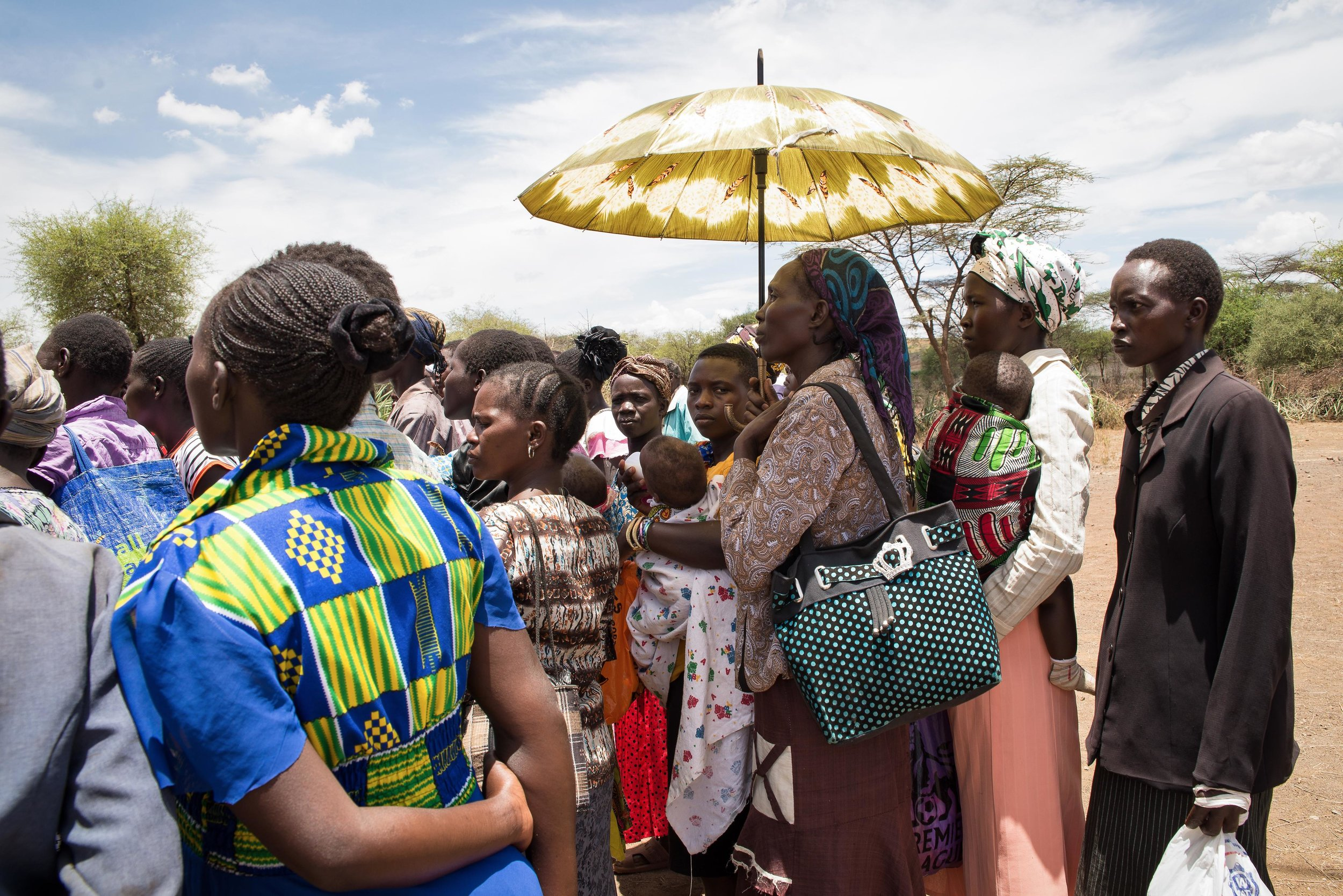 A crowd waits for emergency food relief at the African Inland Church in Mugurin, Kenya. 3 million people are in need of food assistance in Kenya, more than double the number in December 2016.