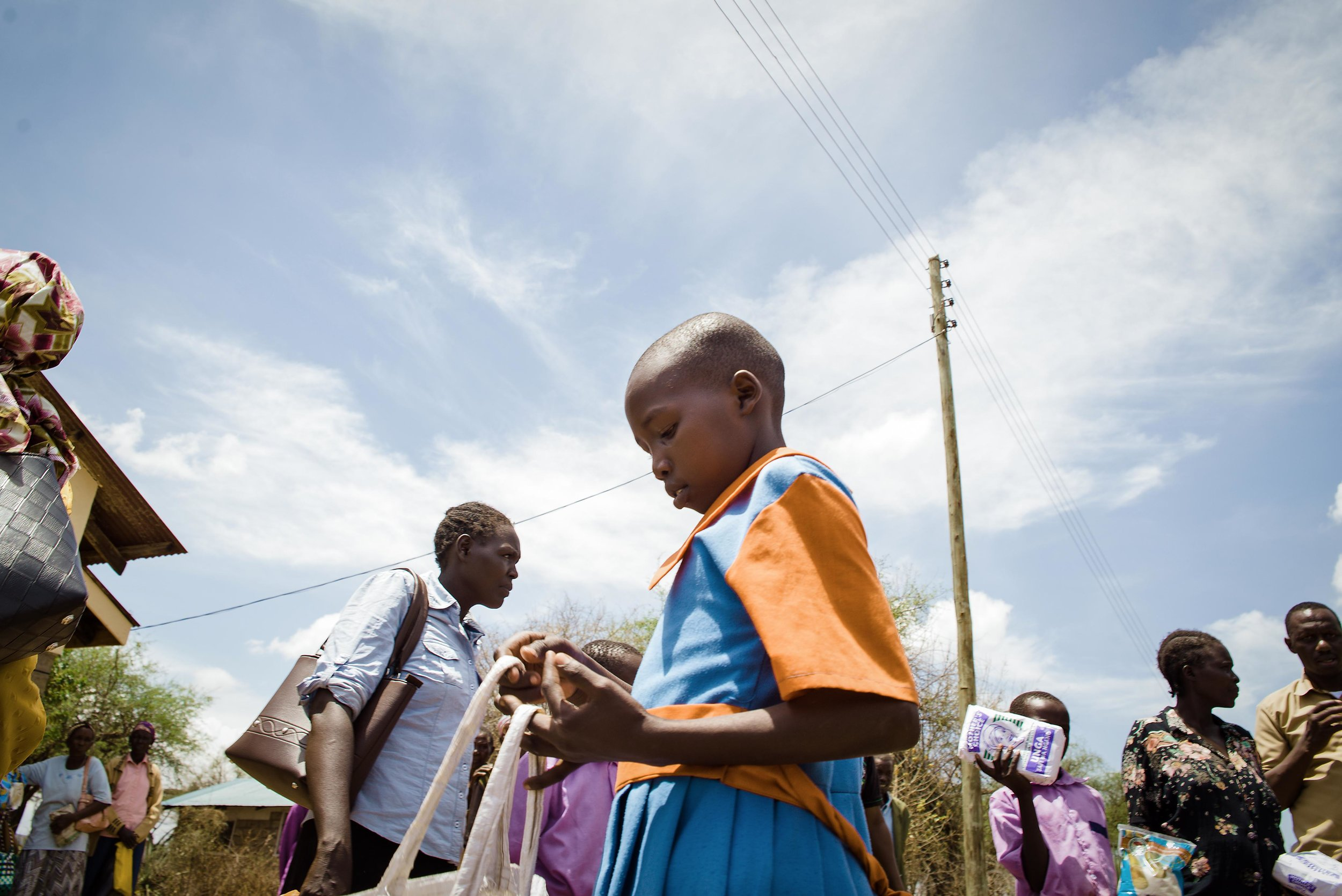 A student inspects her emergency food ration in Baringo County, Kenya. Communities across Kenya's Rift Valley are suffering from severe food insecurity, an ongoing drought and recent infighting in the region only worsening an already dire situation.