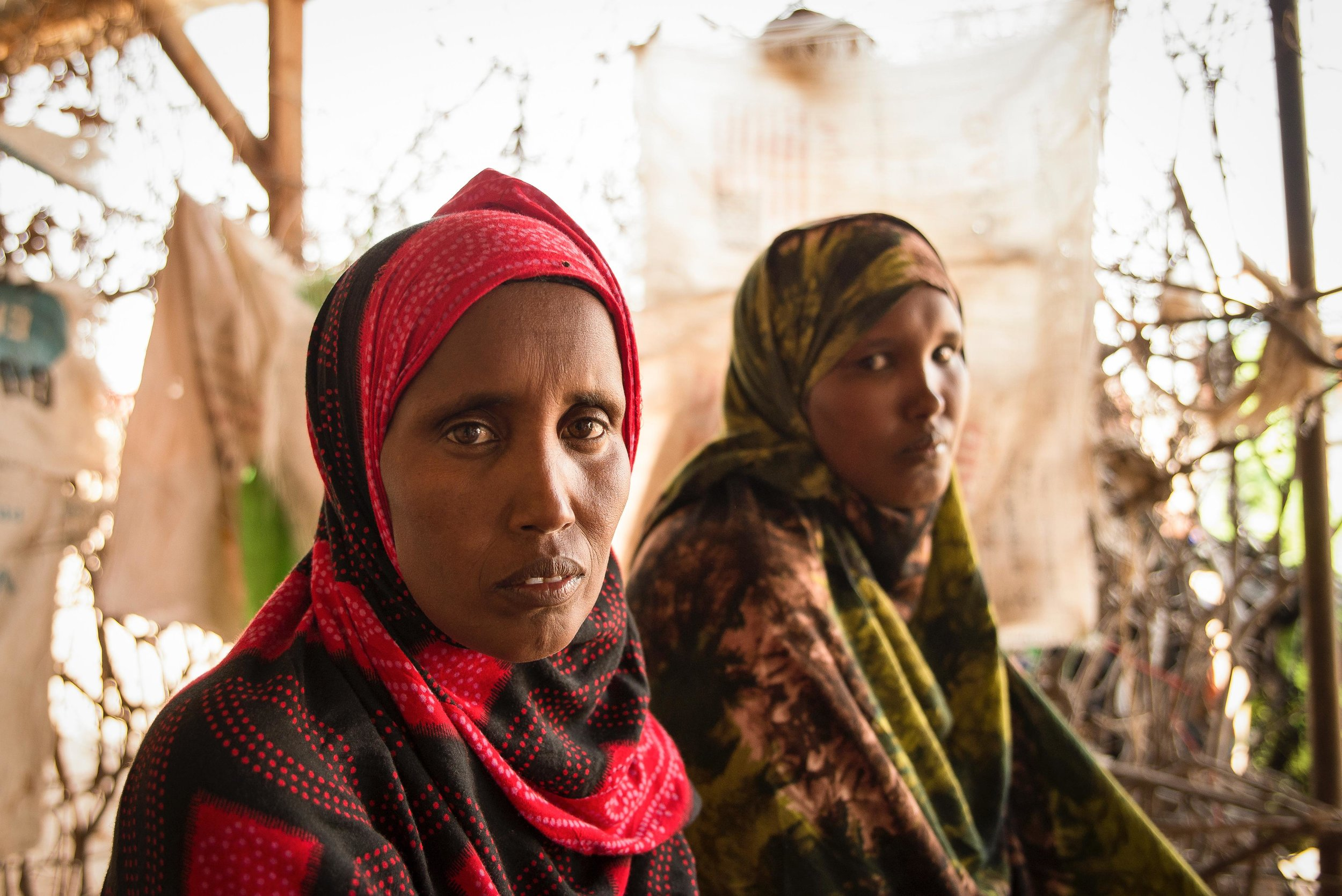Sisters Kadija and Aminda Hussein rest at a shop in Hadado town in Northern Kenya.  The two sisters said they are struggling to feed their children due to the ongoing drought in the region.