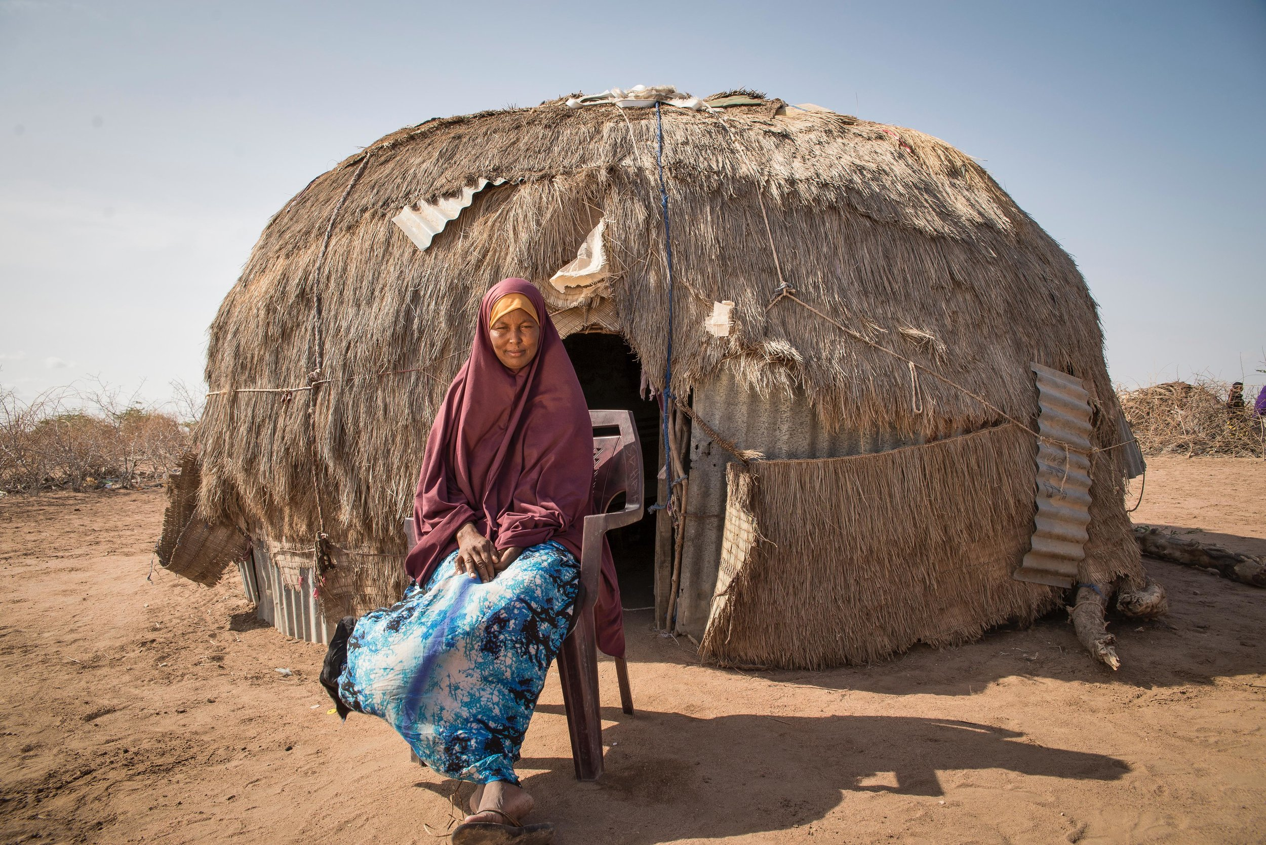 Ibadha Malele, 38, sits outside her home in Hadado Town, Northern Kenya.
