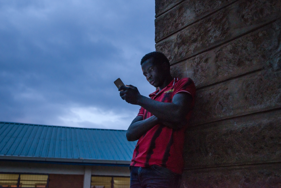 A man waits for voting to end outside a polling station at Olympic Primary School in Nairobi. Katie G. Nelson
