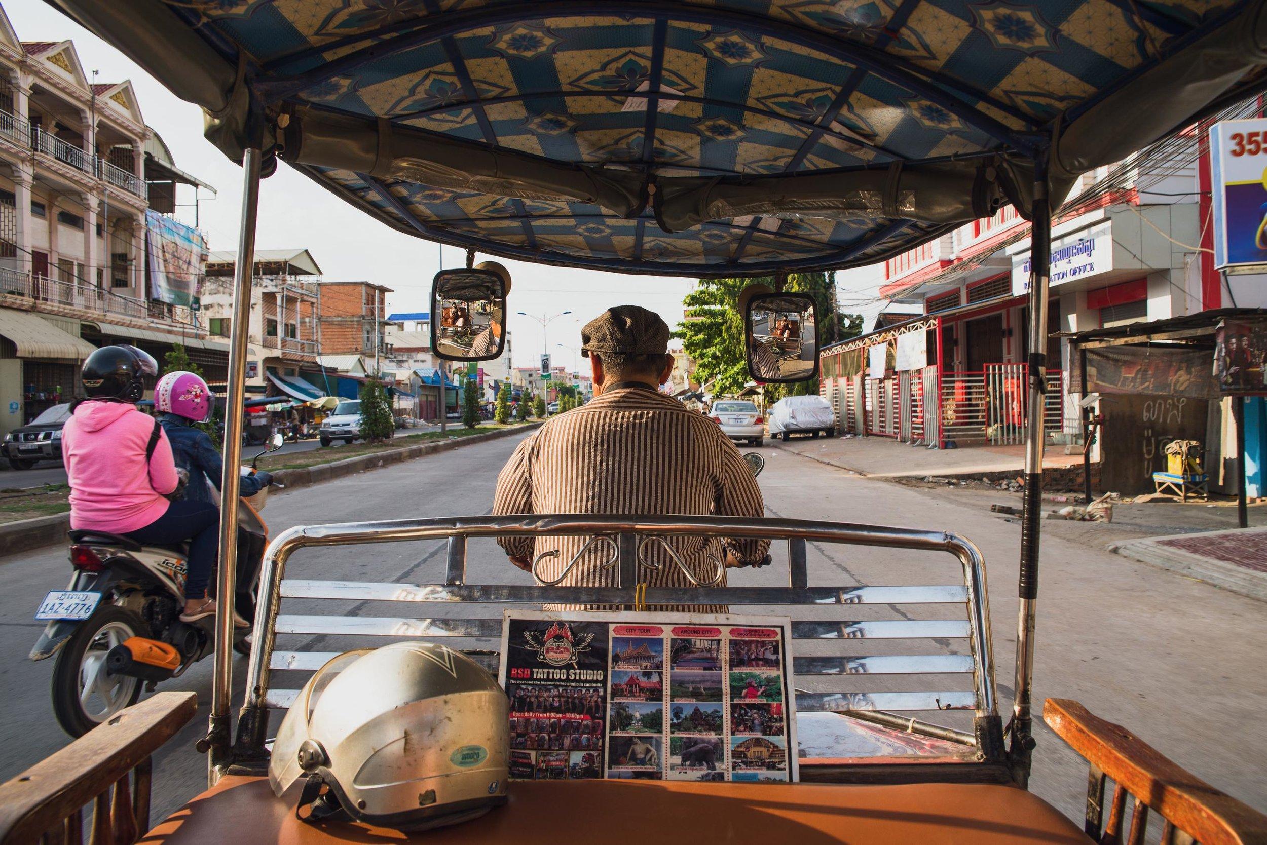 A tuk tuk driver navigates the streets Phnom Penh, Cambodia.