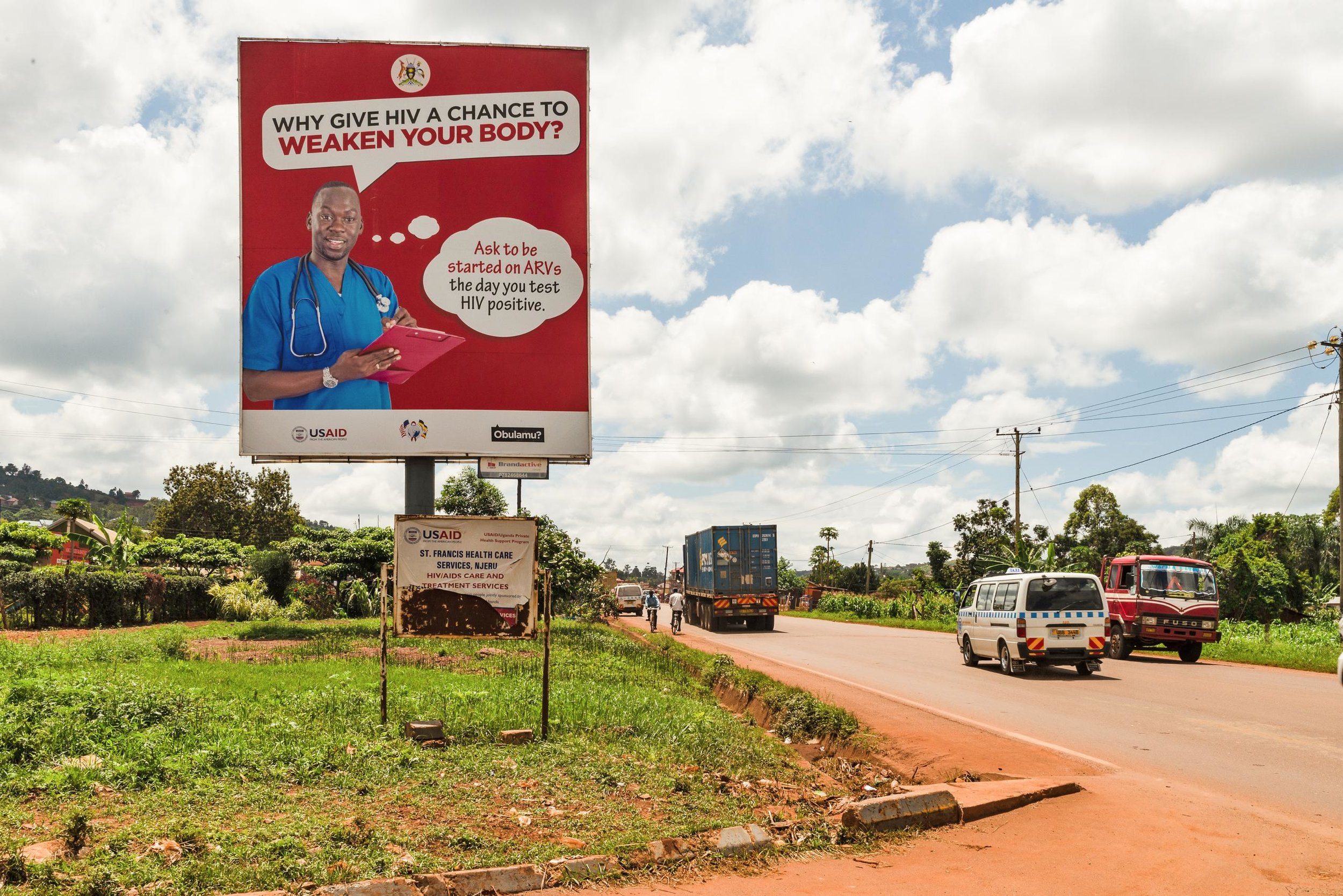 A billboard sponsored by The United States Agency for International Development (USAID) and Uganda's Ministry of Health encourages the public to test and treat themselves for HIV in Jinja, Uganda. Photo: PRI/Katie G. Nelson