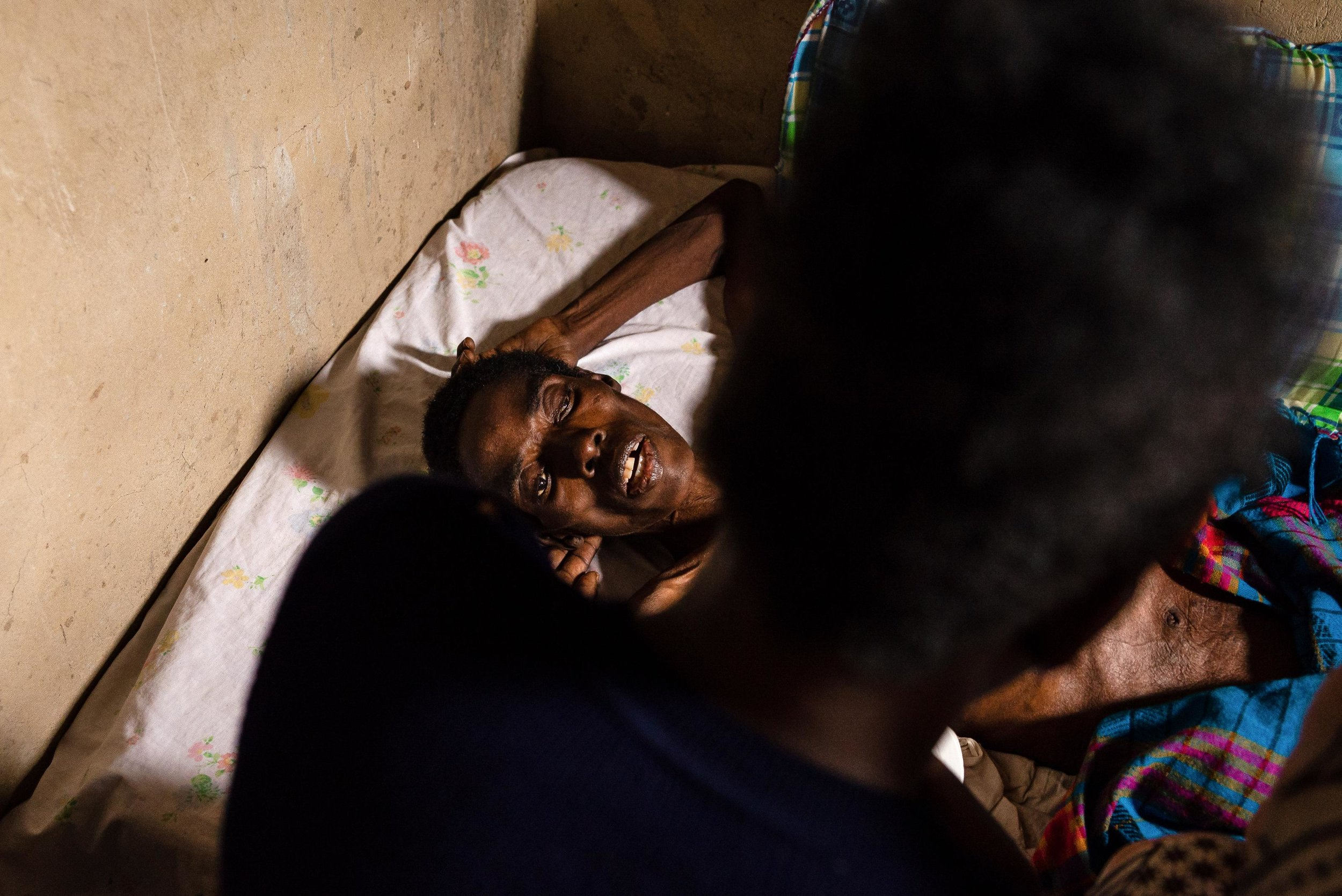 hospice-hiv-uganda-patient-nurse.jpg
