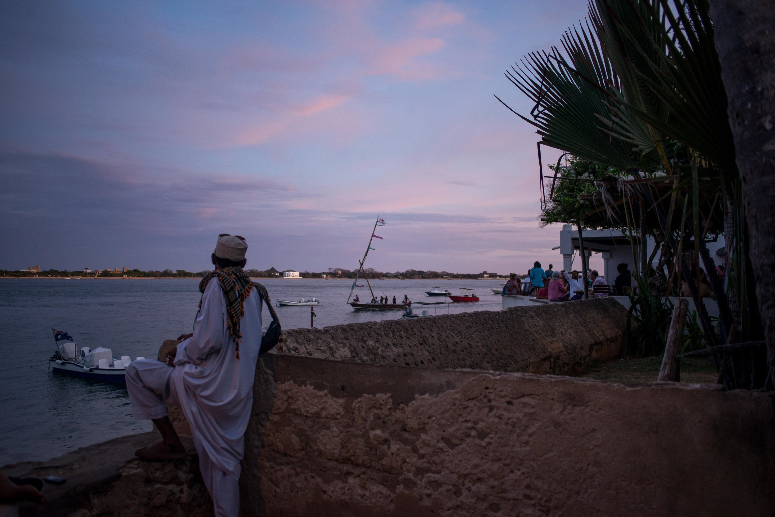 A man watches the sunset in Lamu, Kenya. March 2018.